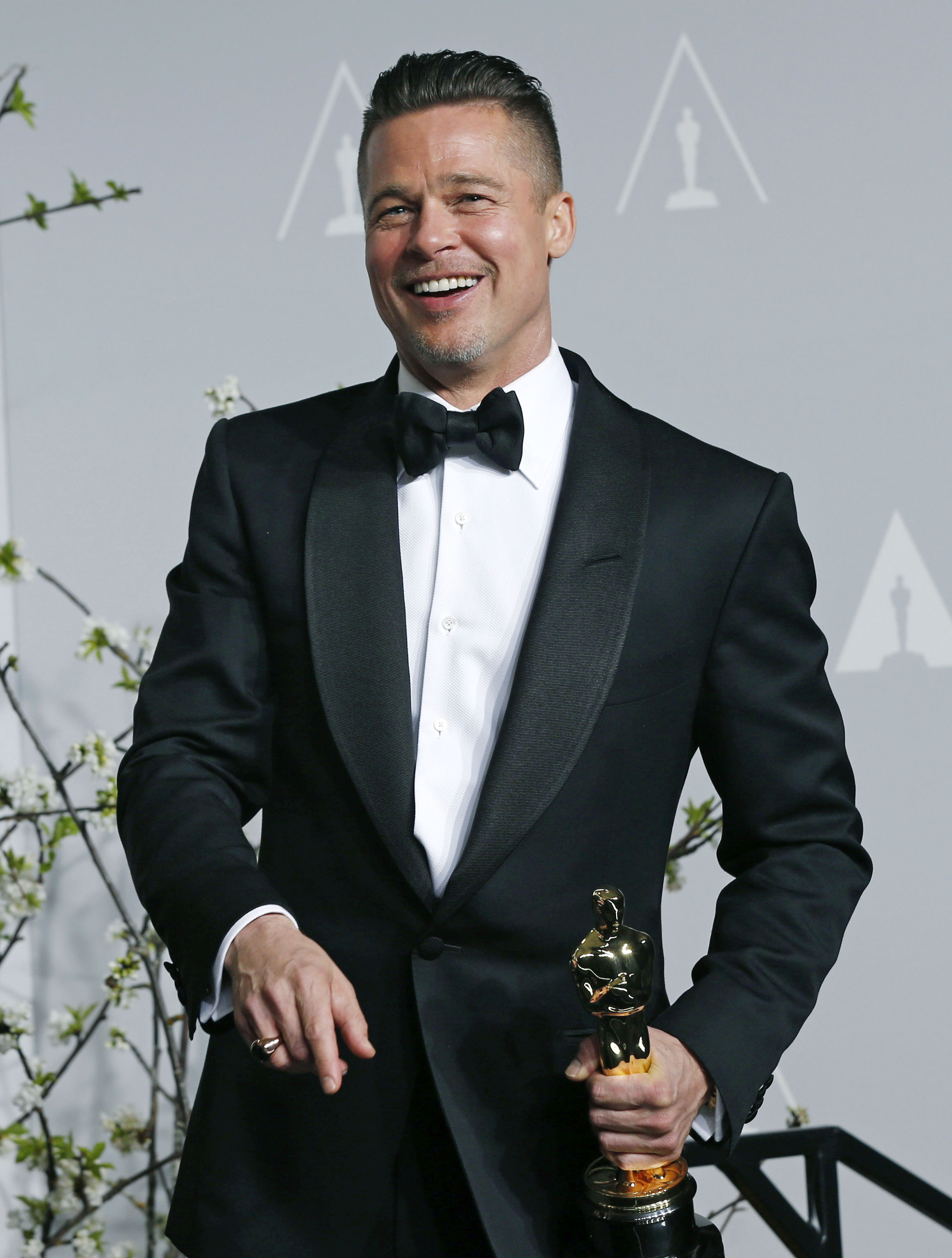Brad Pitt at the 86th Academy Awards in Hollywood on March 2, 2014 after winning best picture for  12 Years a Slave .