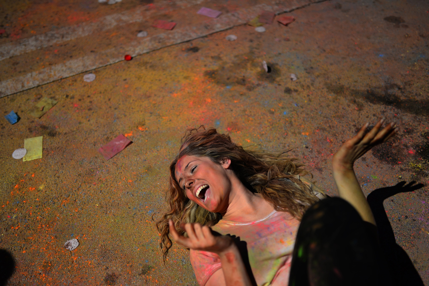 Apr. 6, 2014. A woman enjoys the atmosphere at the Holi Festival of Colours in Barcelona, Spain. The festival is fashioned after the Hindu spring festival Holi, which is mainly celebrated in the north and east of India.
