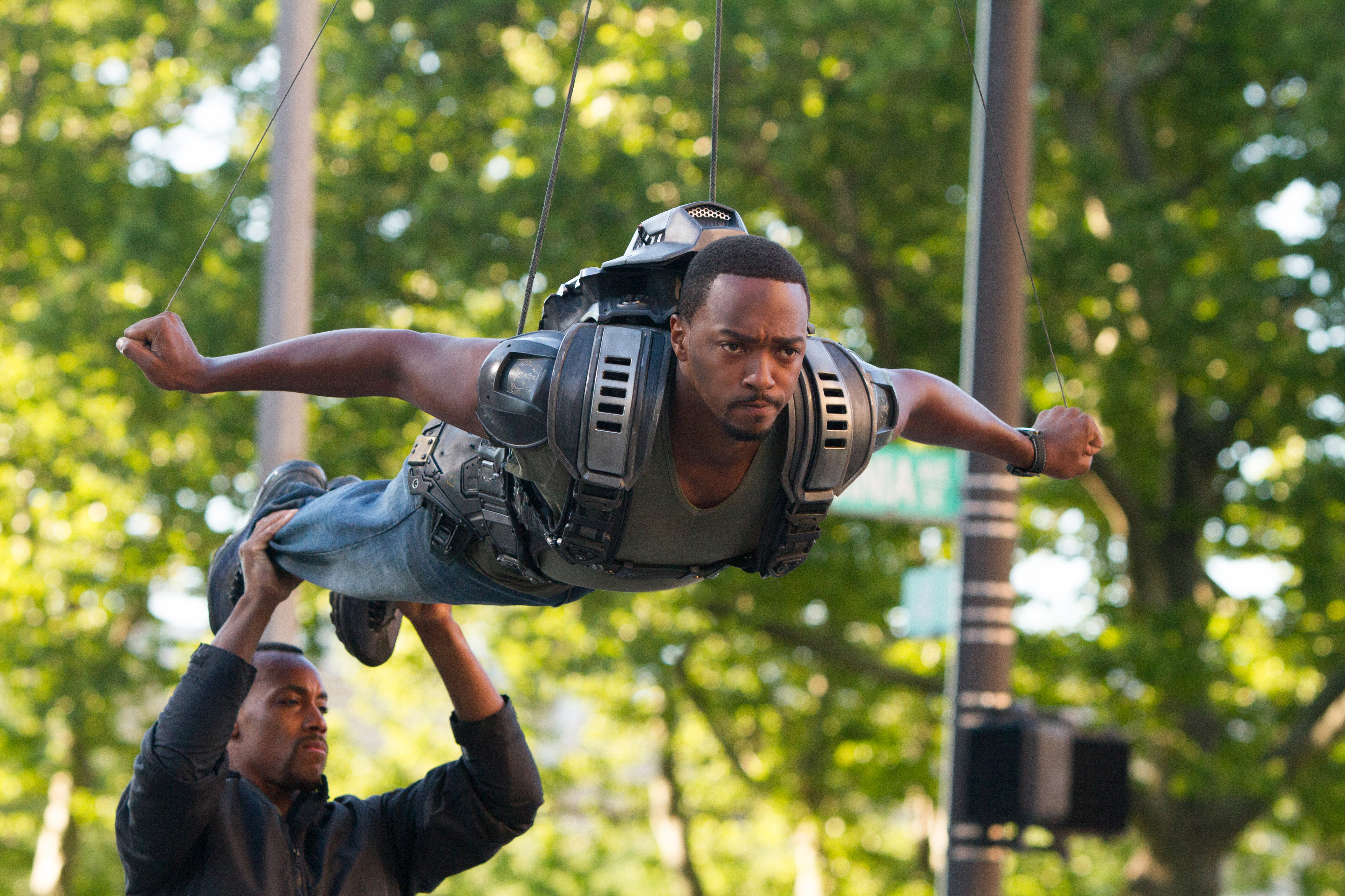 Mackie is suspended for a scene where he flies with his wing pack as the Falcon.