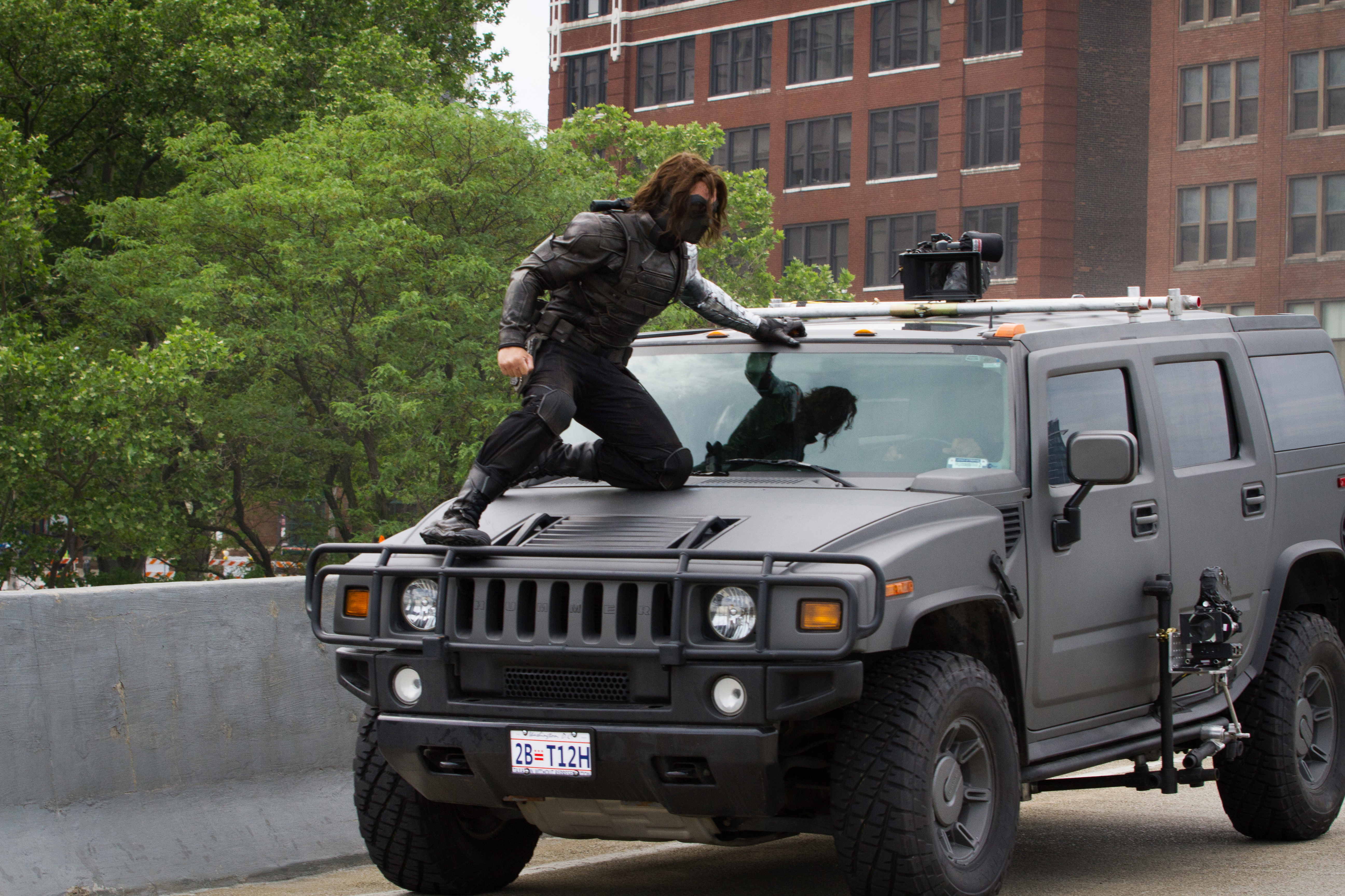 Sebastian Stan, the Winter Soldier, braces himself during a chase scene.