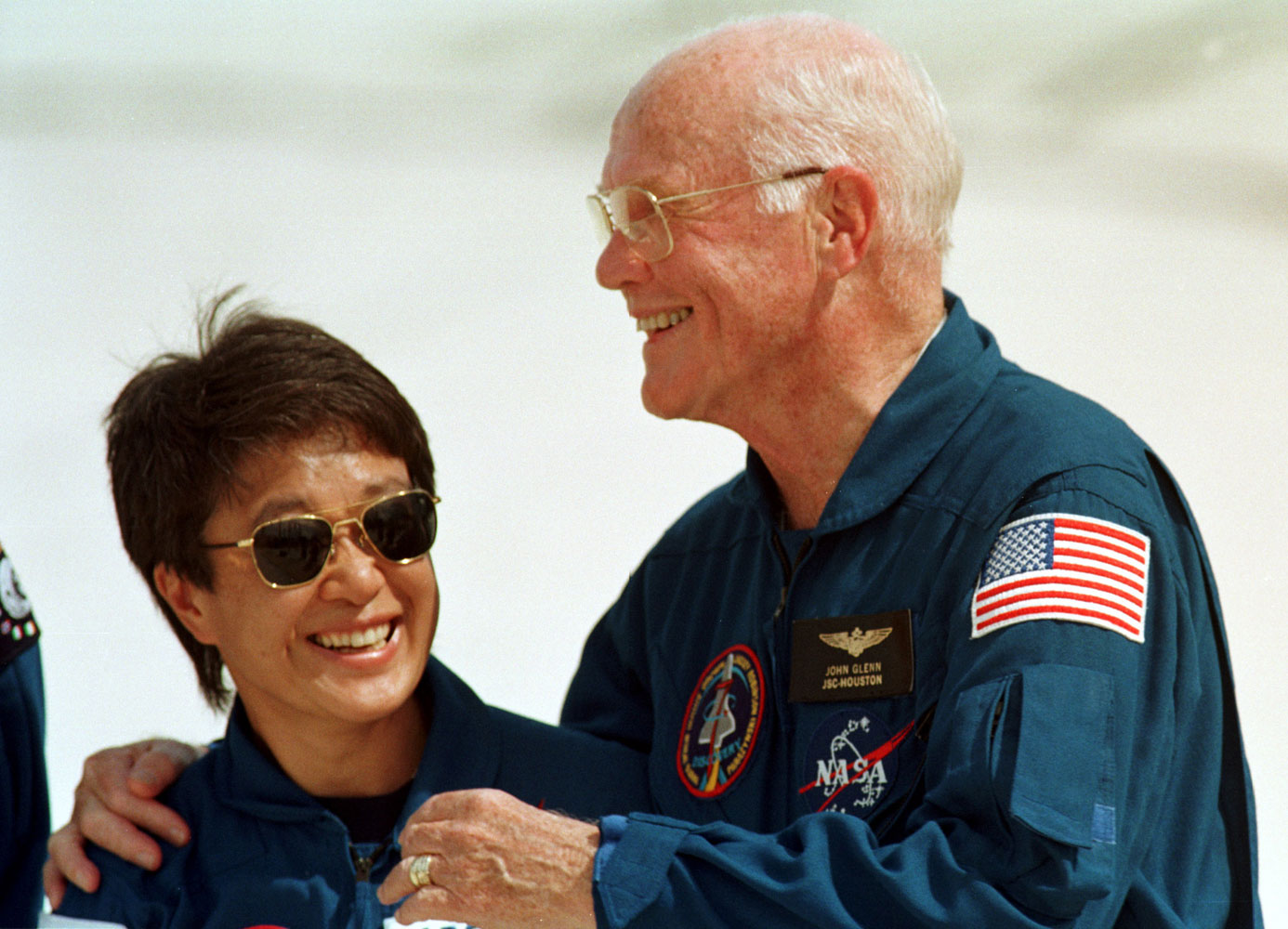Japanese astronaut Chiaki Mukai and John Glenn at a press conference, on Oct. 8, 1998. Mukai was Japan's first woman in space.
