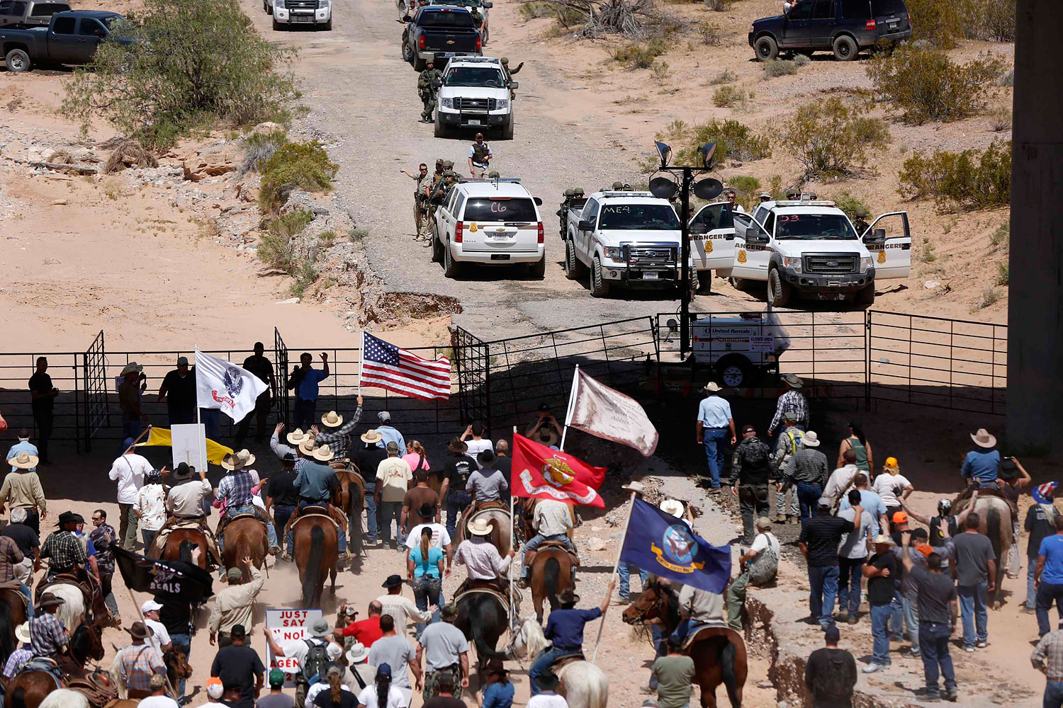 Protesters gathered at the Bureau of Land Management's base camp, where cattle seized from rancher Cliven Bundy was being held, near Bunkerville, Nevada, April 12, 2014.