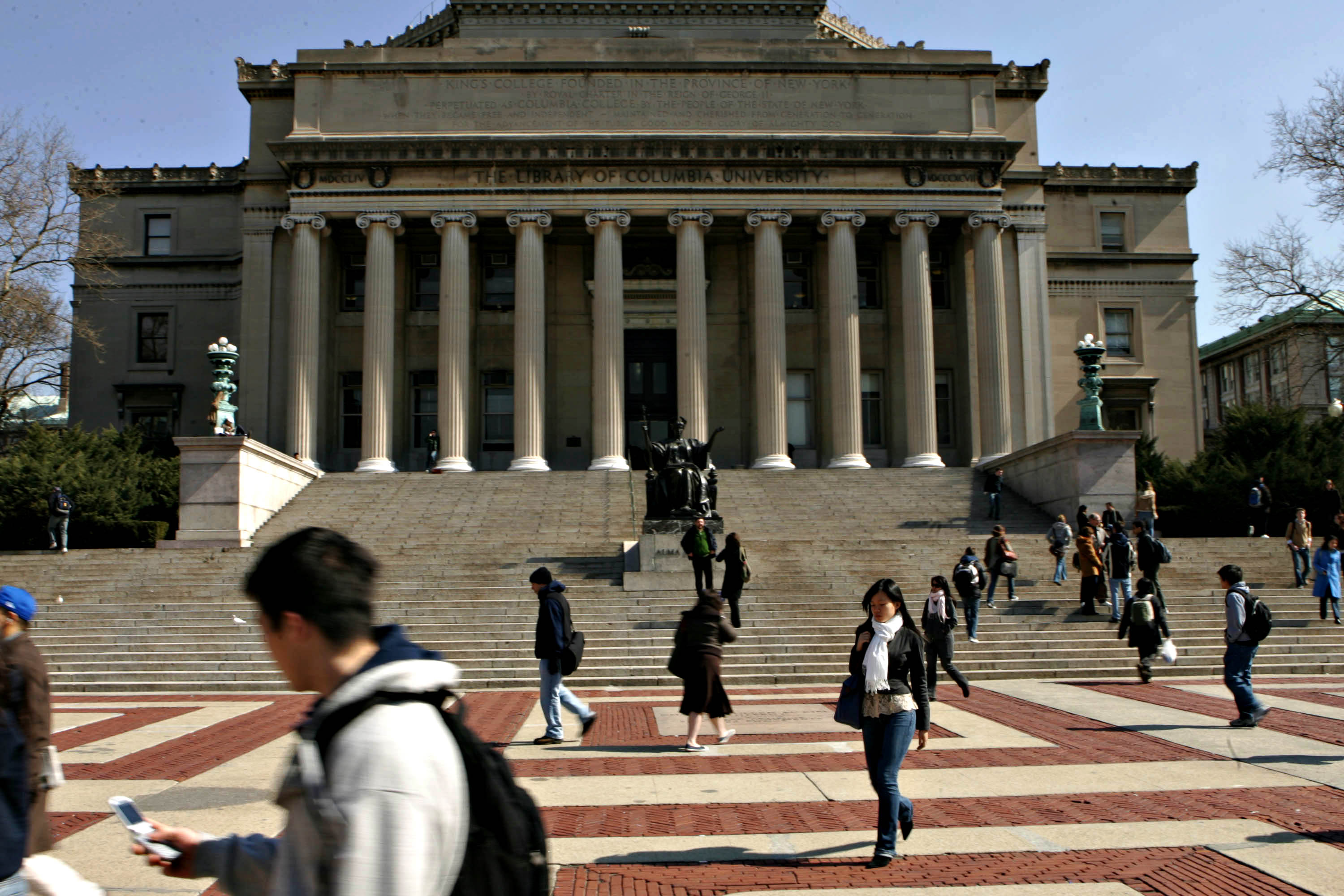 Students walk across the campus of Columbia University in New York City