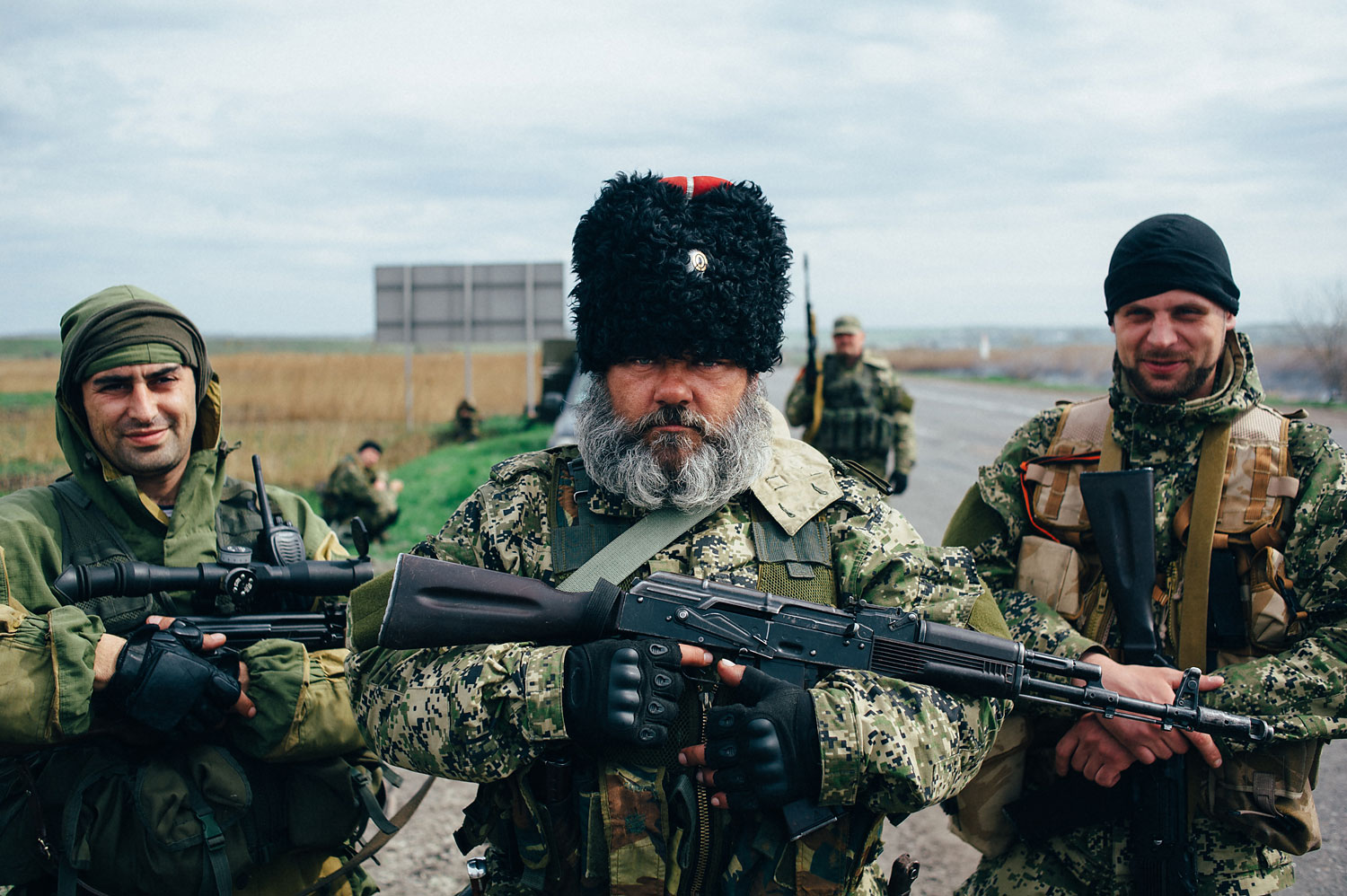 Alexander Mozhaev, a pro-Russian separatist whose photograph has appeared in numerous publications in recent days and who says he is not employed by the Russian state, stands with fellow separatists in the town of Slavyansk on April 20