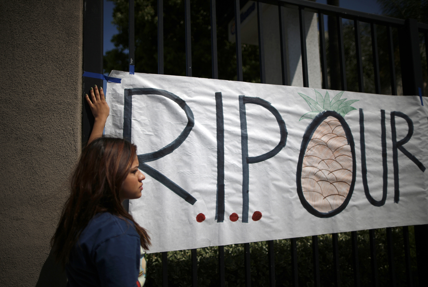 Students put up a sign for El Monte High School student Adrian Castro, outside the school in El Monte, California April 11, 2014.