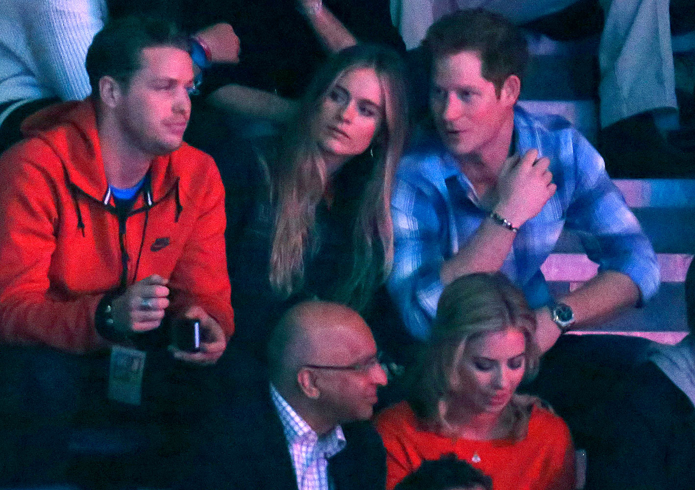 Britain's Prince Harry (R) and Cressida Bonas (2nd R) watch the WE Day UK event at Wembley Arena in London March 7, 2014.
