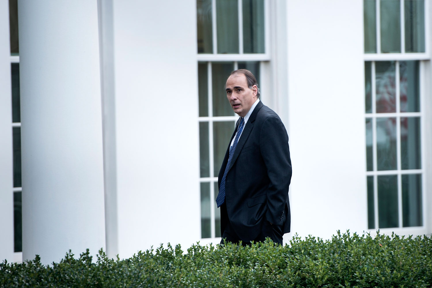 Former White House advisor David Axelrod walks into the West Wing of the White House on Nov. 15, 2013 in Washington.