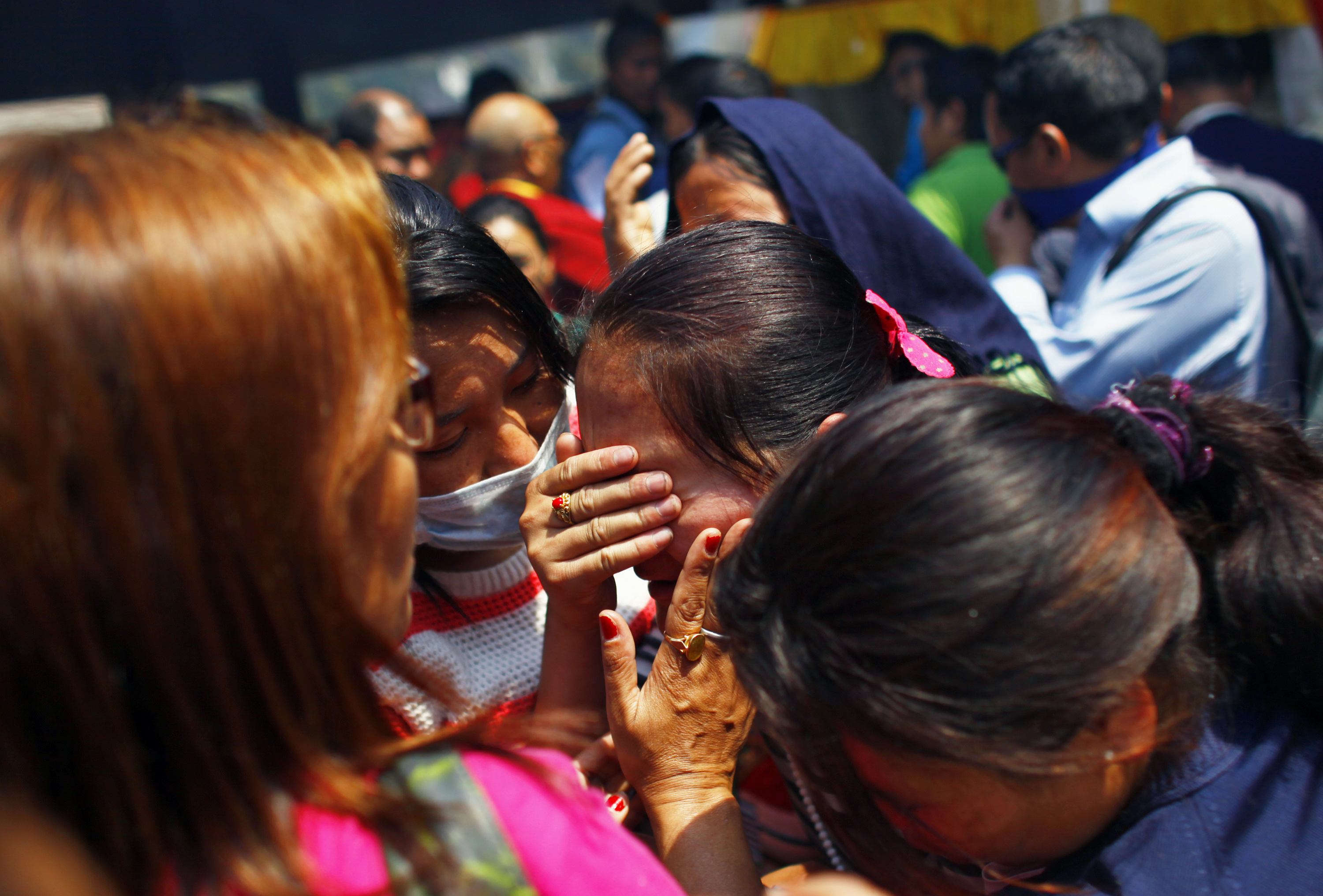 Relatives of mountaineers, killed in an avalanche on Mount Everest, cry during the funeral ceremony in Katmandu, Nepal on April 21, 2014.