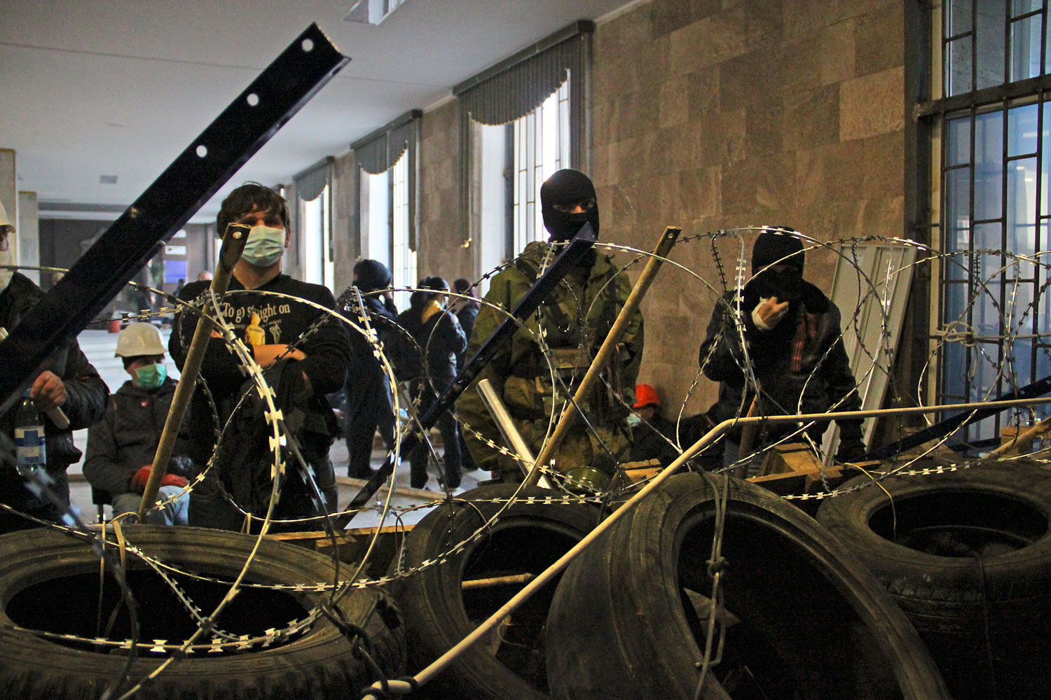 Activists prepare a barricade inside a government building in Donetsk, Ukraine, on April 7, 2014