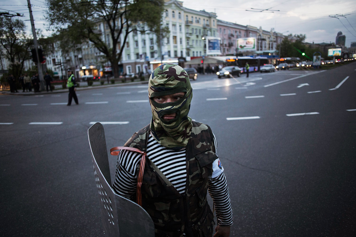A pro-Russian activist holds a shield after clashing with pro-Ukrainians during a pro-Ukraine rally in Donetsk, Ukraine, on Monday, April 28, 2014