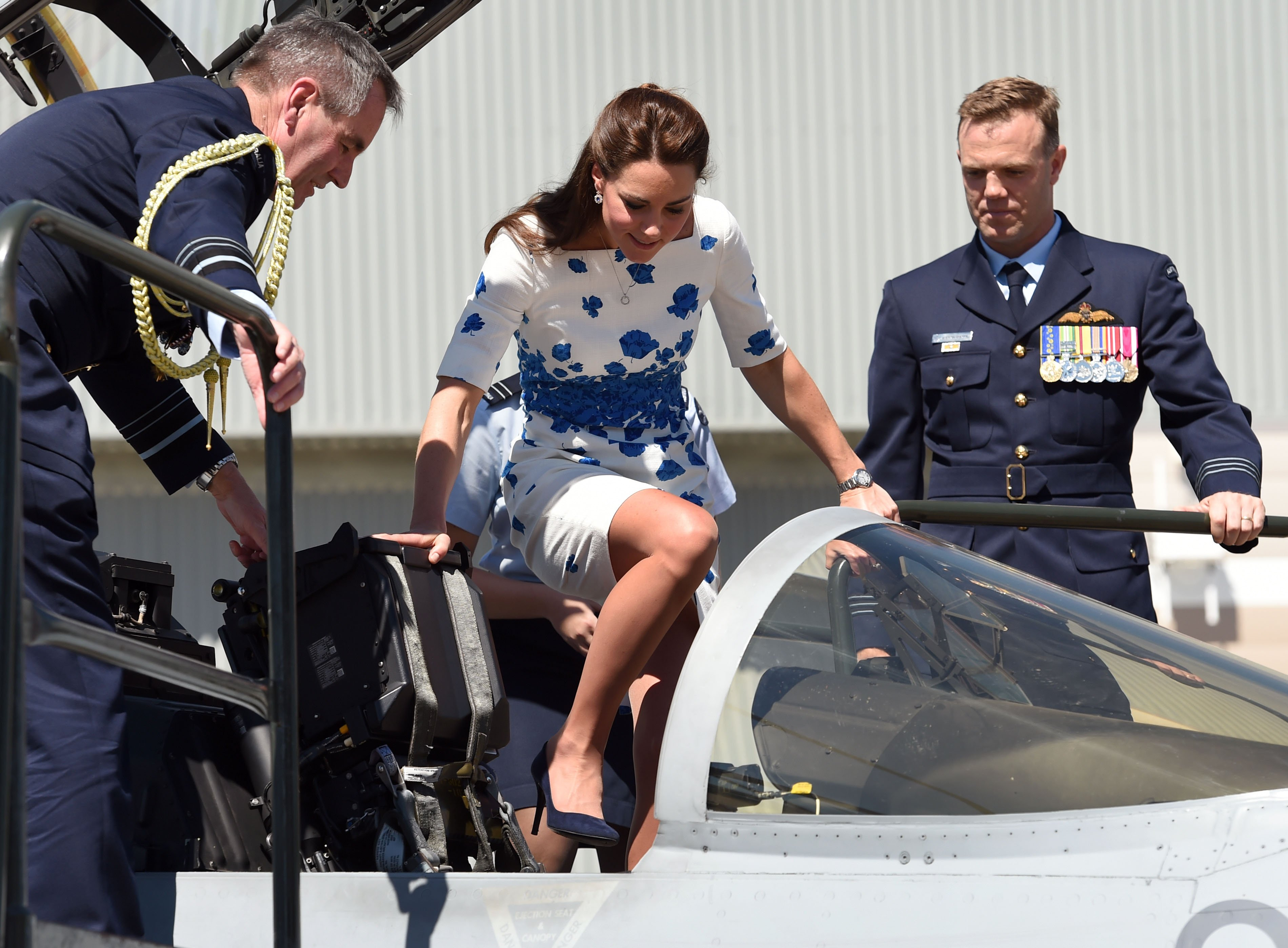 <strong>Straighten Up and Fly Right</strong>Flanked by Chief of Air Force, Air Marshall Geoff Brown (left), and Commanding Officer of Number 1 Squadron , Wing Commander Stephen Chappell (right), Catherine, the Duchess of Cambridge, makes her way into the cockpit of a RAAF Super Hornet of 1 Squadron at the Royal Australian Airforce Base at Amberley on April 19, 2014 in Brisbane, Australia.