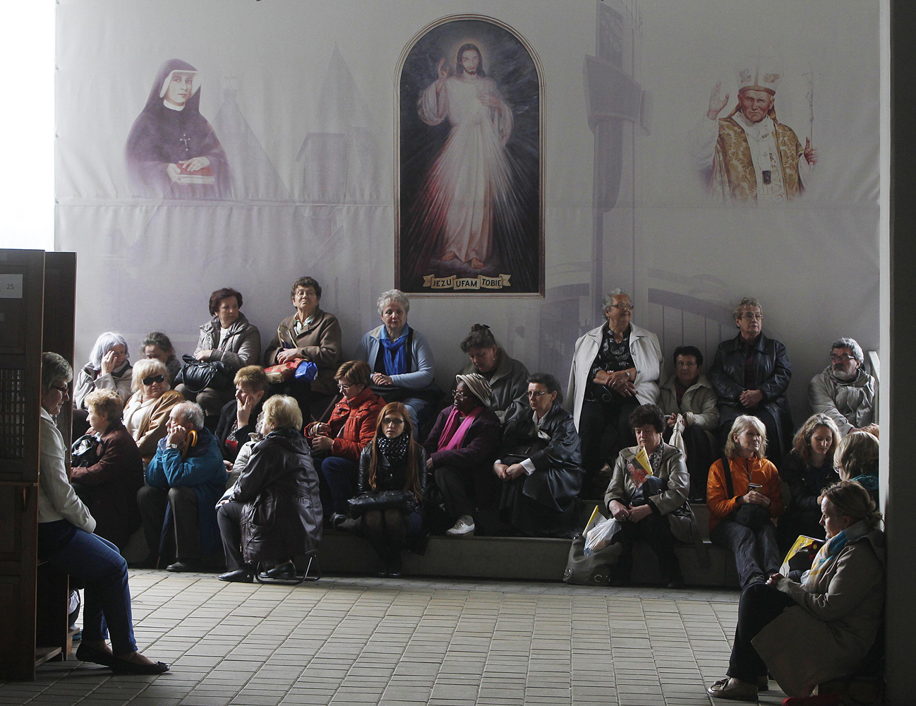 Apr. 27, 2014. Faithful attentively listen to Pope Francis as he declares Polish-born Pope John Paul II a saint in a Vatican ceremony.  Thousands of people gathered to watch the live ceremony in front of God's Mercy sanctuary in Krakow, Poland.