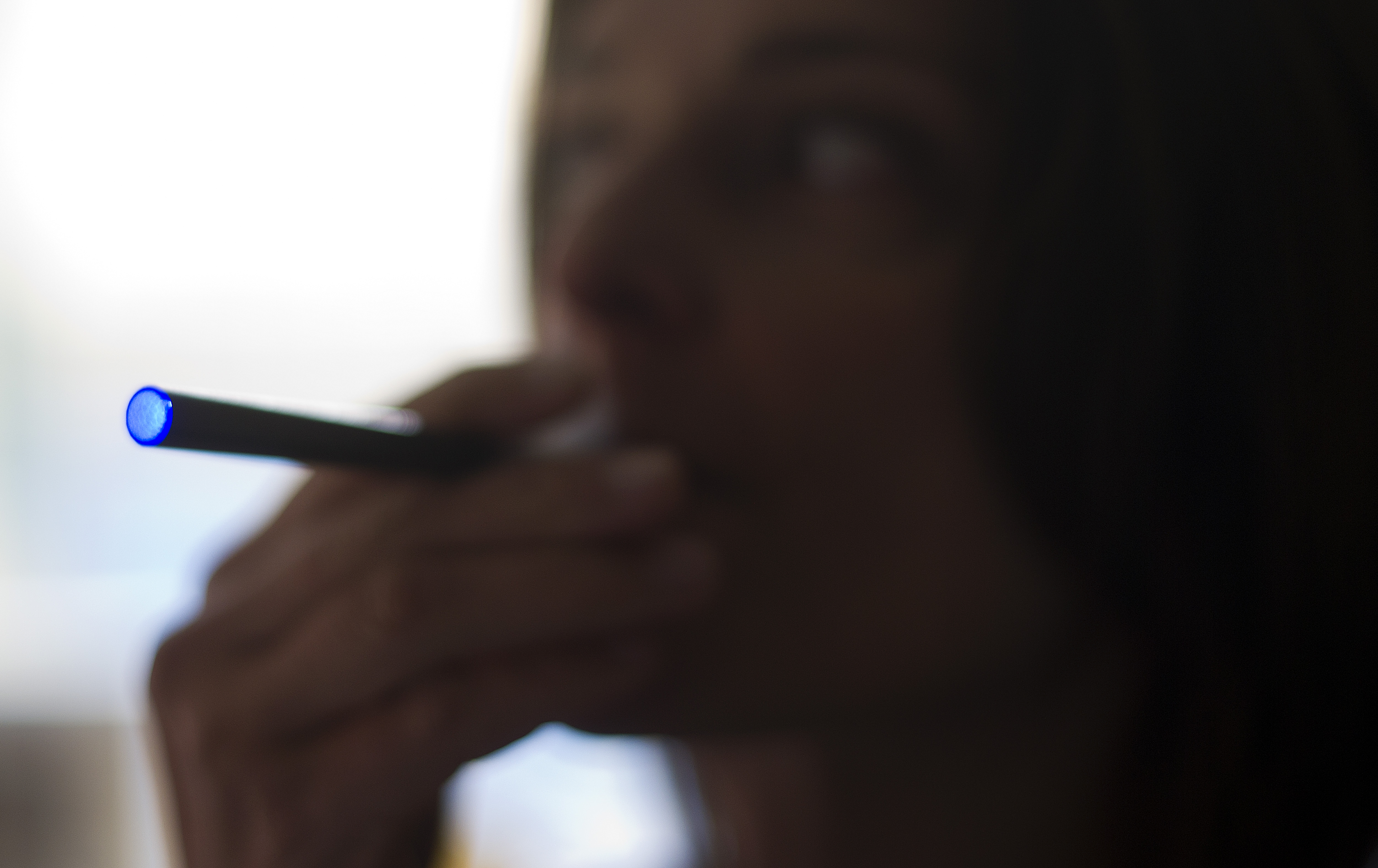 A woman smokes an  Blu  e-cigarette in Washington, D.C., on Sept. 25, 2013.