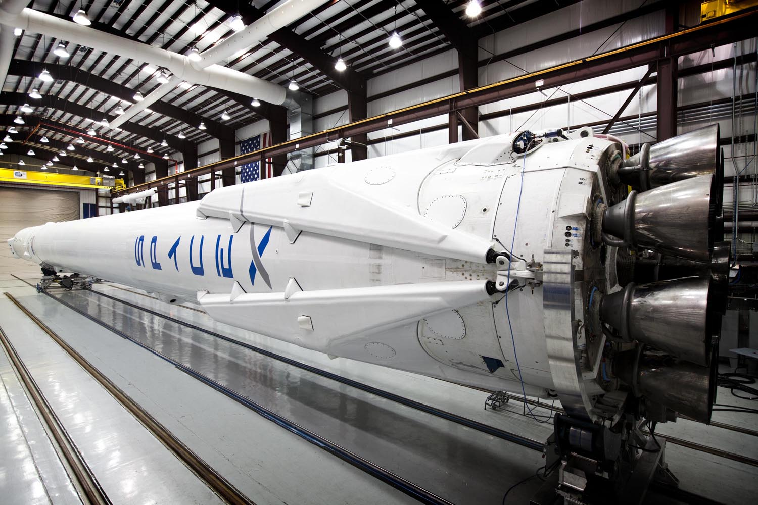 Falcon 9 awaits its upcoming launch in SpaceX's hangar with landing legs attached on March 12, 2014.