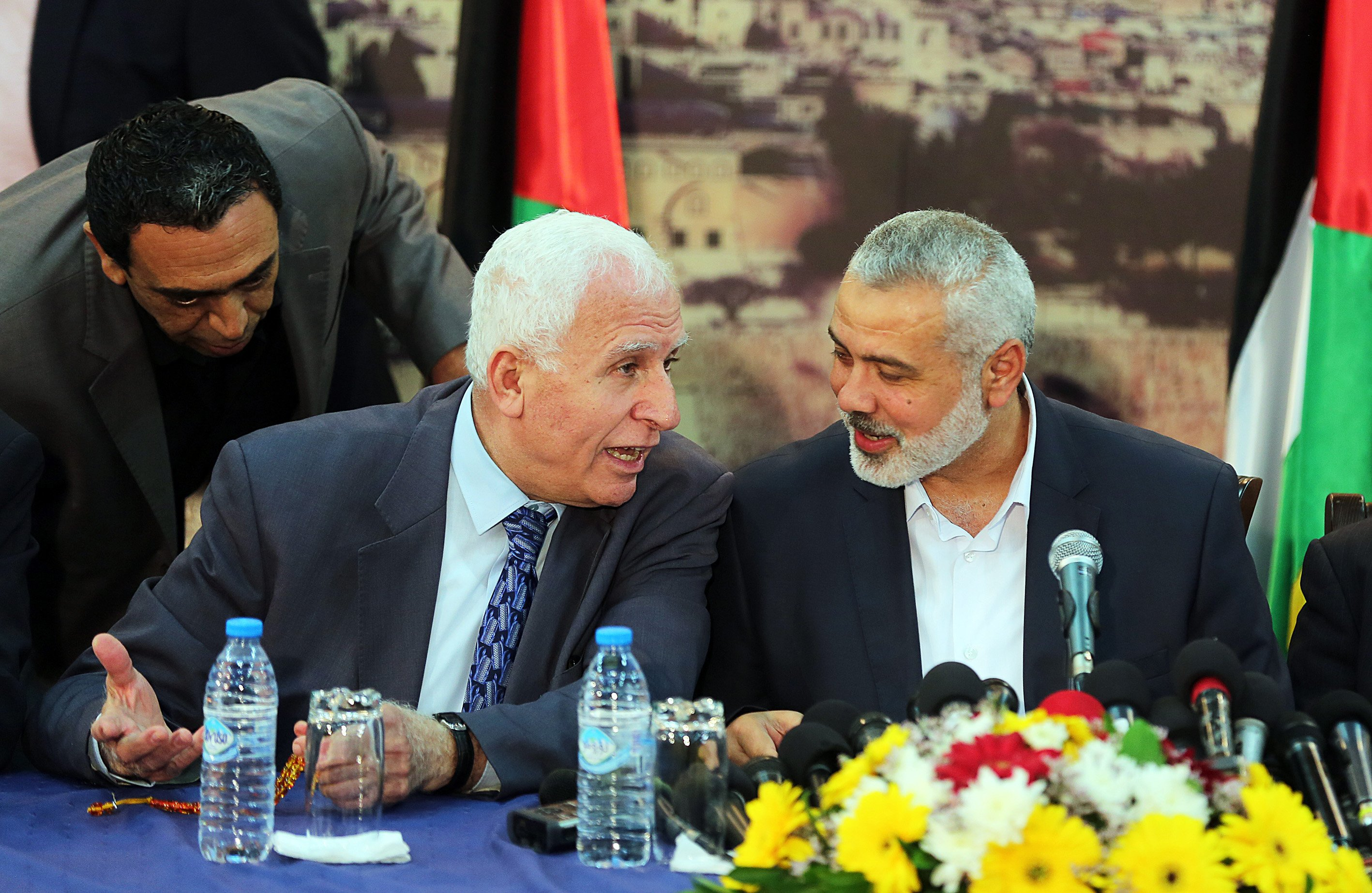 Fatah movement leader Azzam al-Ahmad, left, and Palestinian Prime Minister Ismail Haniyeh speak during a press conference following the meeting to end Palestinian divisions between Fatah and Hamas movement in Gaza City on April 23, 2014