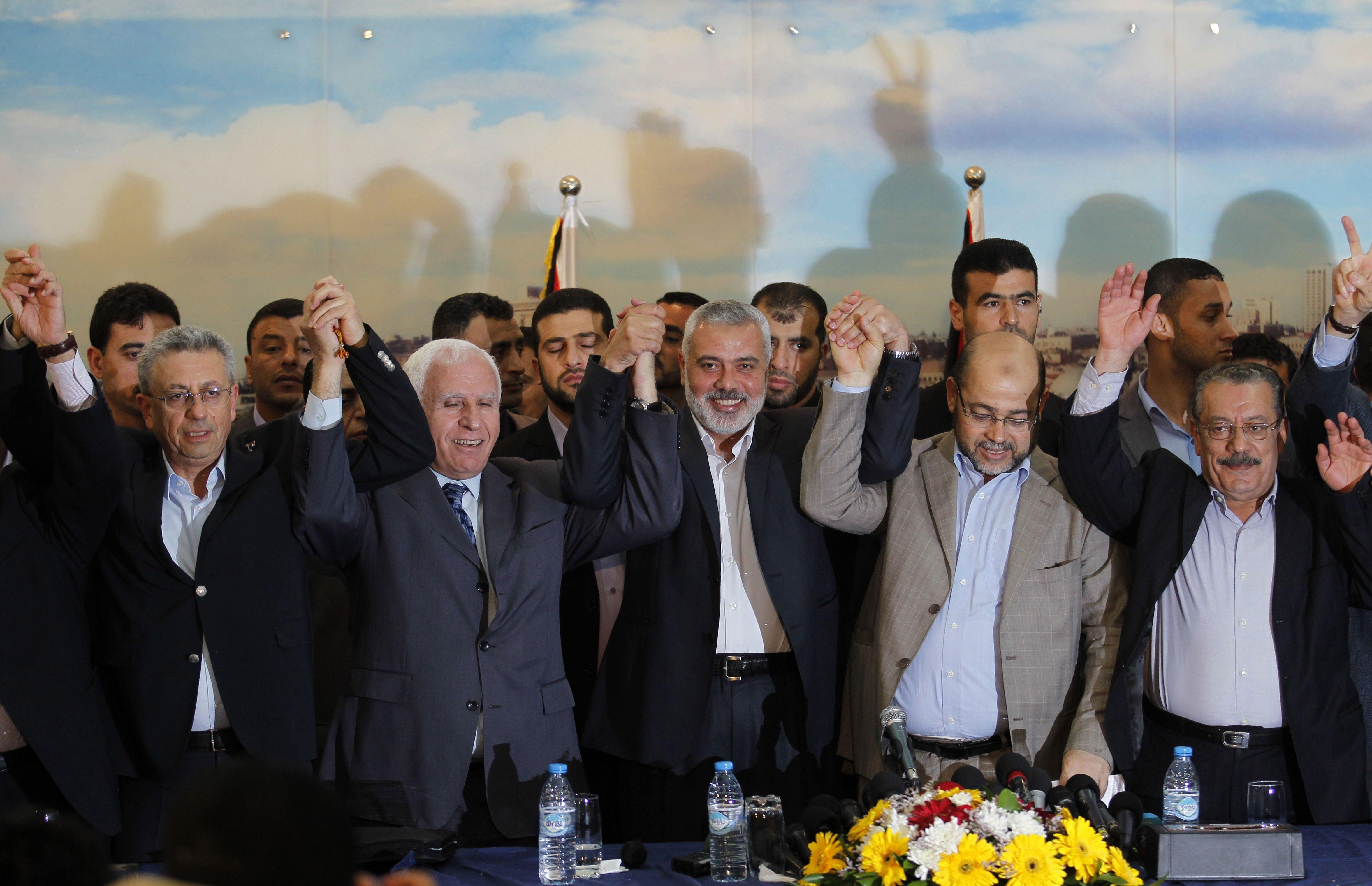 From left: Palestinian legislator Mustafa Barghouti, Palestinian Fatah delegation chief Azzam al-Ahmed, Hamas prime minister in the Gaza Strip Ismail Haniya, Hamas deputy leader Musa Abu Marzuk, and secretary-general of the Palestinian Arab Front (PAF) Jameel Shehadeh in Gaza on April 23, 2014.