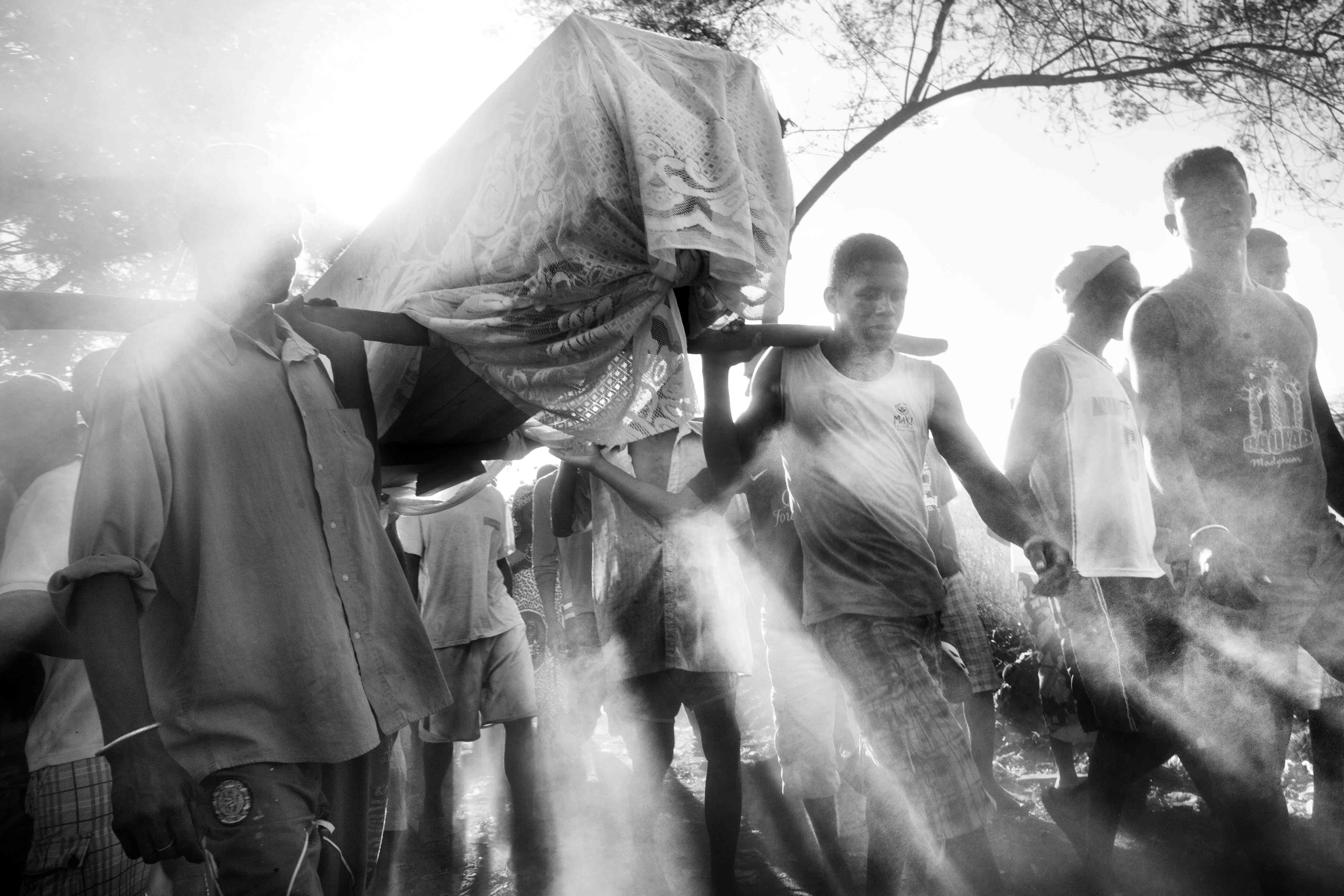 Friends of Dina carry his coffin to the cemetery during his funeral. Aug. 8, 2013.