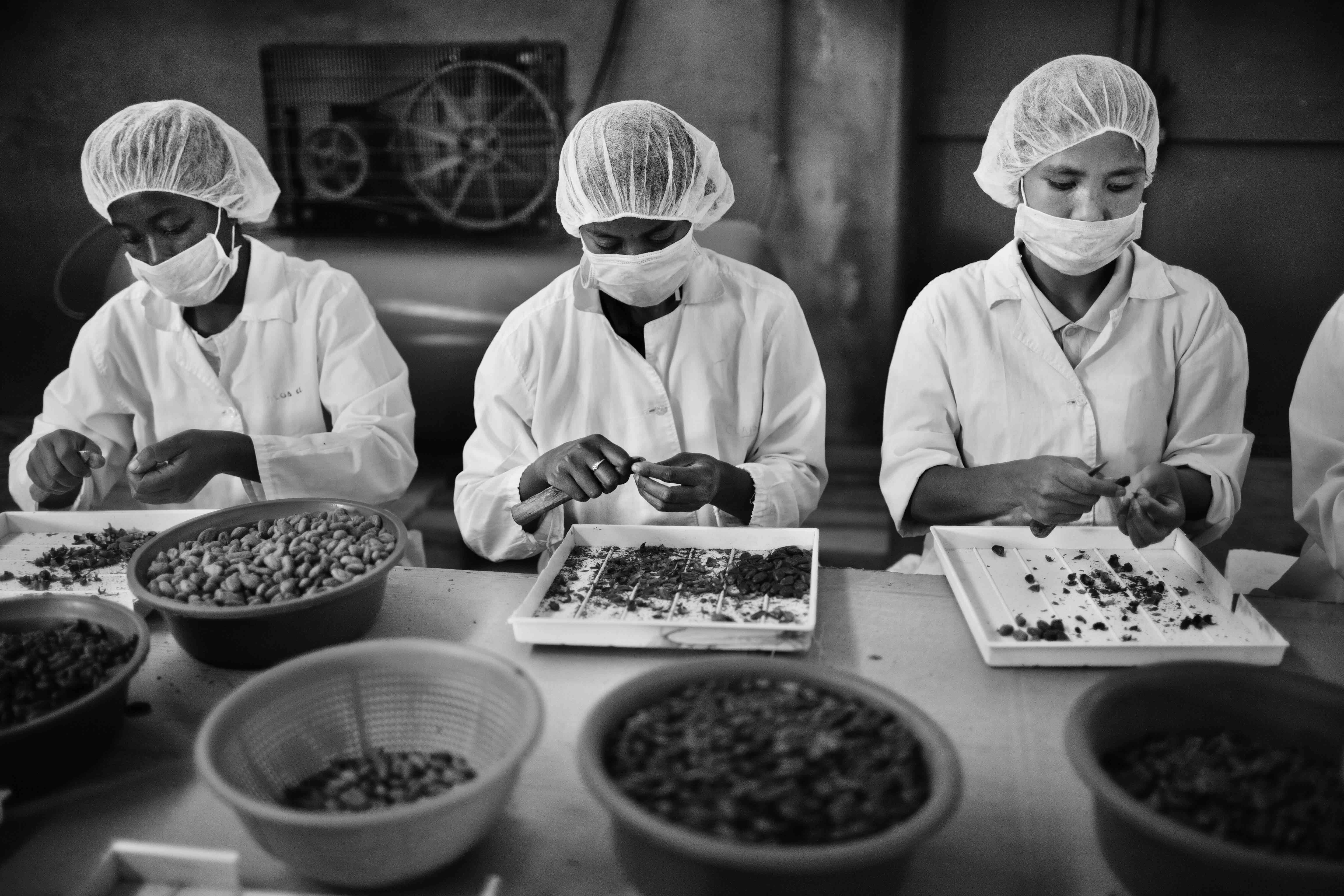 Employees prepare chocolate for the Easter holiday season at the Cinagra chocolate factory located on the outskirts of Antananarivo. March 2013.