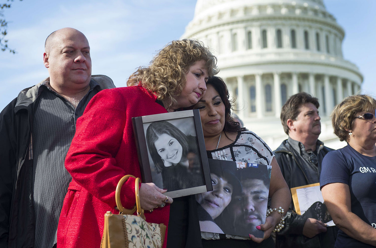 Mary Ruddy, whose daughter Kelly died in the crash of a 2005 Chevy Cobalt, hugs Rosie Cortinas, whose son Amador died in the crash of a 2005 Chevy Cobalt as well, during a press conference with the family members of deceased drivers on Capitol Hill in Washington, DC, April 1, 2014.