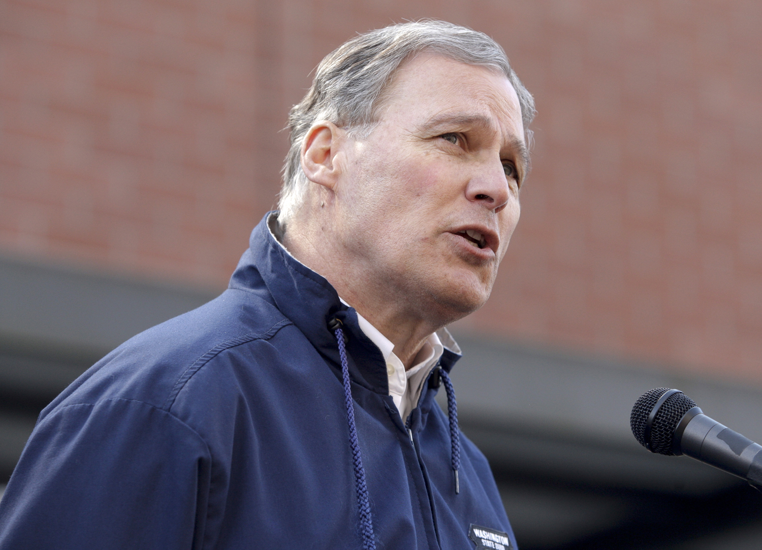 Washington Governor Jay Inslee wrote President Barack Obama on Tuesday to ask for more federal assistance for his disaster struck state. Jason Redmund—Reuters