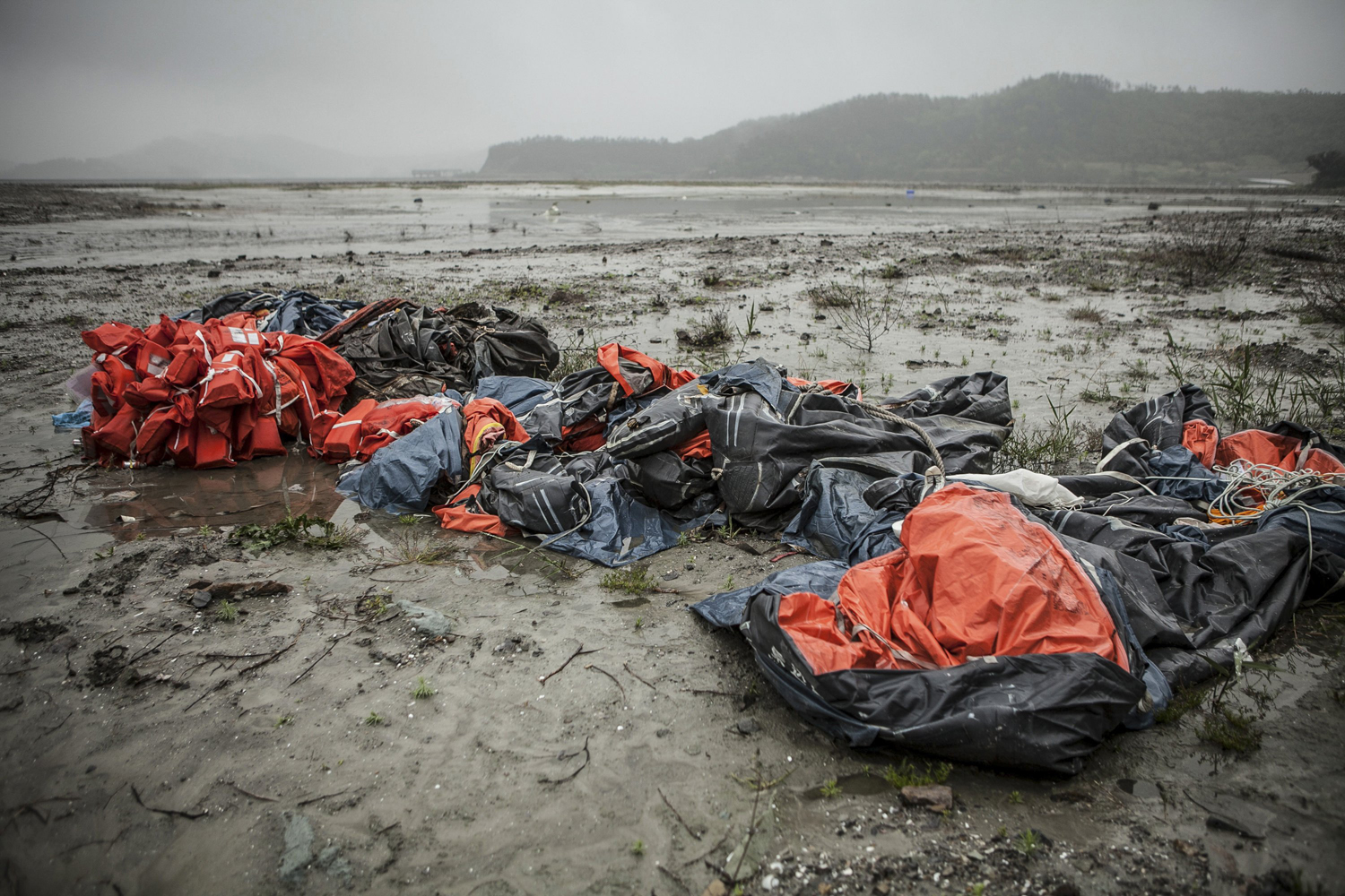 Apr. 28, 2014. Life vests and rafts from the sunken Sewol ferry sit at Paeng Mok Harbor in Jindo, South Korea.