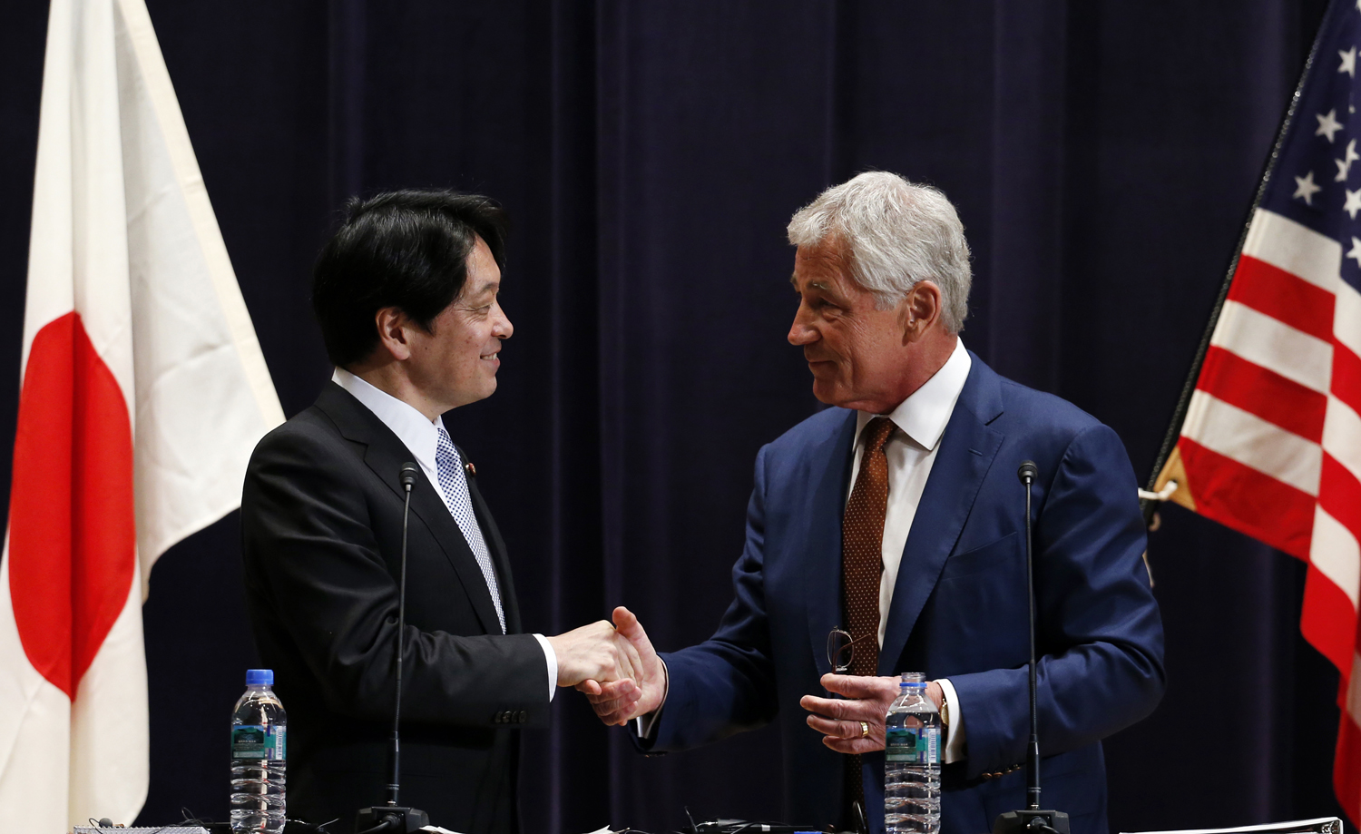 From right: U.S. Secretary of Defense Chuck Hagel shakes hands with his Japanese counterpart Itsunori Onodera at the end of their joint news conference at the Defense Ministry in Tokyo on April 6, 2014.