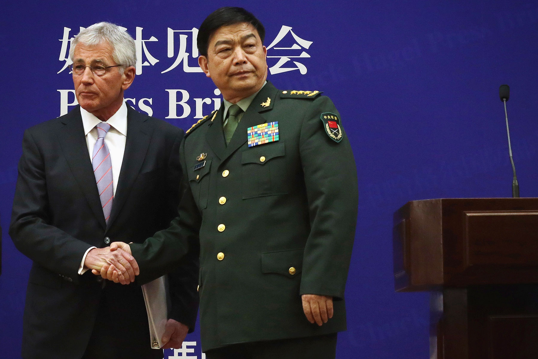 U.S. Secretary of Defense Chuck Hagel (L) and Chinese Minister of Defense Chang Wanquan (R) shake hands at the end of a joint news conference at the Chinese Defense Ministry headquarters April 8, 2014 in Beijing, China