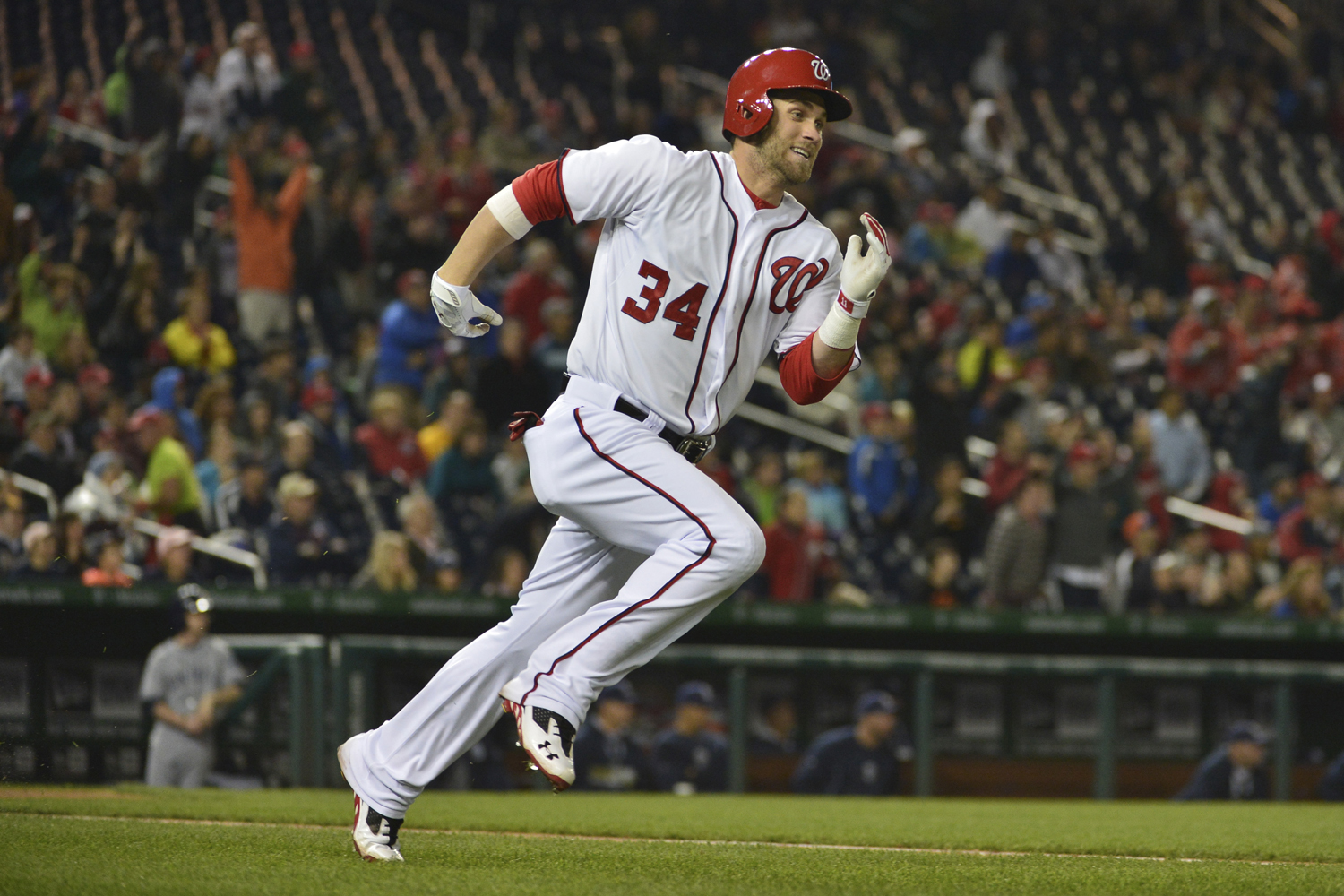 Washington Nationals left fielder Bryce Harper runs down first base after hitting a three-run triple in the third inning against the San Diego Padres at Nationals Park