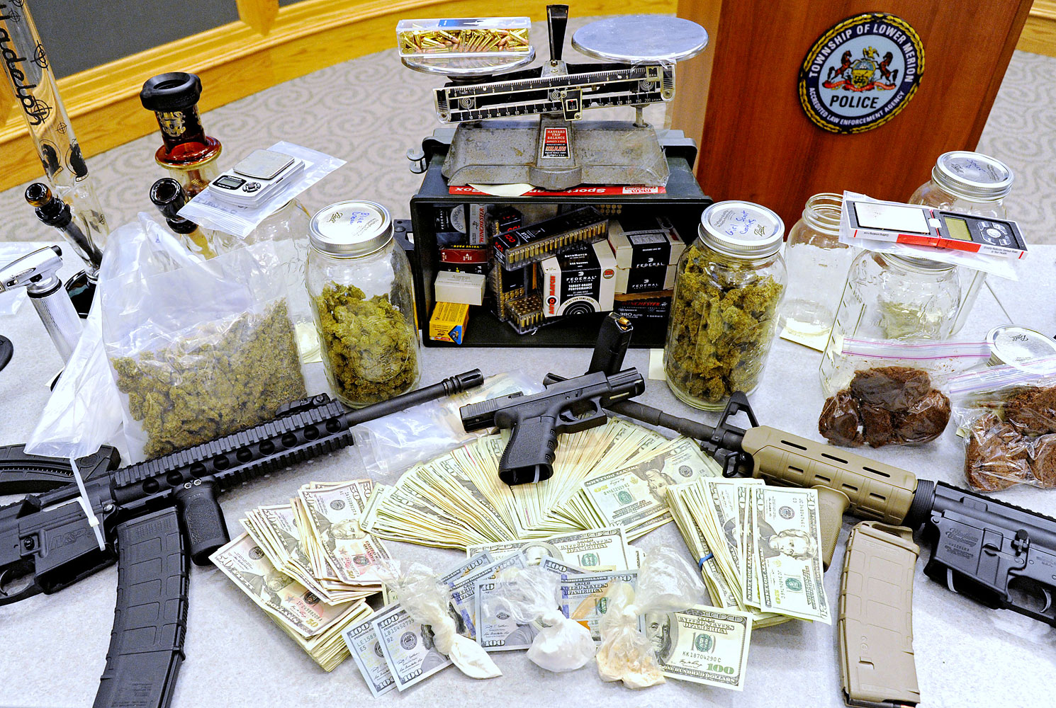 Drugs, guns and other illegal items were seized when Lower Merion Police broke up a drug-distribution ring in Montgomery County, Pa.