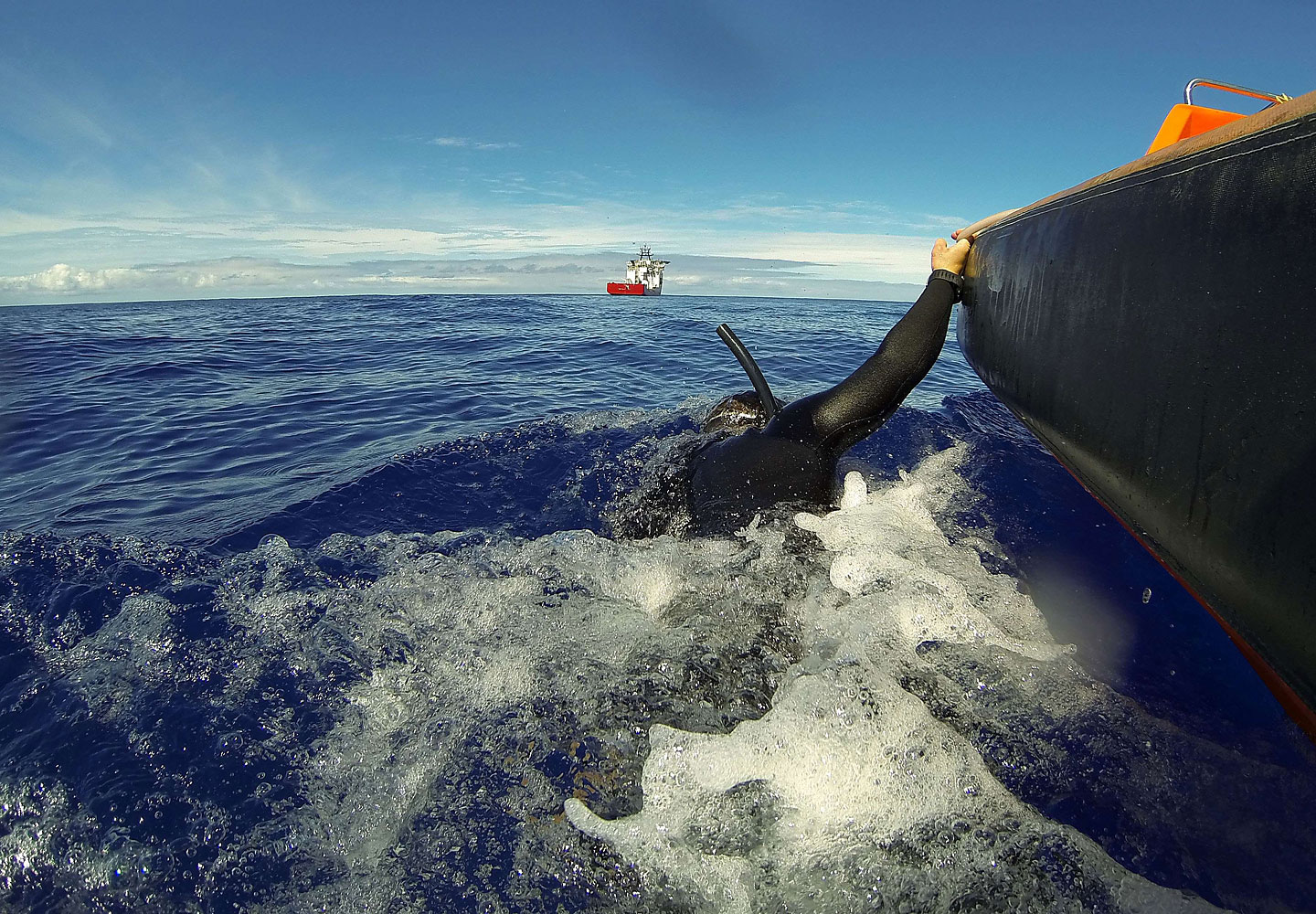 A handout photo taken on April 7, 2014 and released on April 8 by Australian Defence shows Able Seaman Clearance Diver Michael Arnold being towed by Australian Defence Vessel Ocean Shield's fast response craft as he scans the water for debris from missing Malaysia Airlines Flight MH 370 in the southern Indian Ocean.