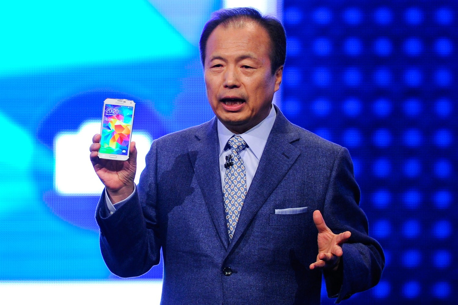 Samsung president and CEO J.K. Shin announces the Galaxy S5 smartphone at Mobile World Congress in Barcelona on February 24, 2014