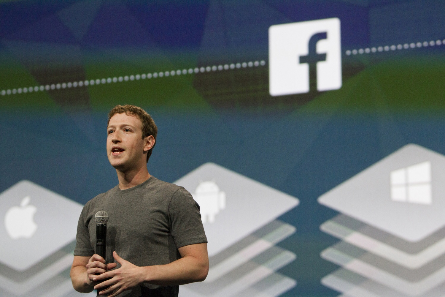Facebook CEO Mark Zuckerberg compares the Facebook platform for mobile developers to iOS, Android and Windows Phone at the f8 conference in San Francisco on April 30, 2014