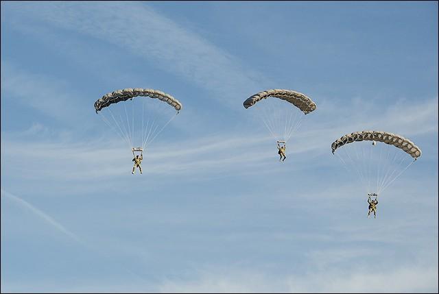 Members of the FBI's Hostage Rescue Team practice their parachuting skills.