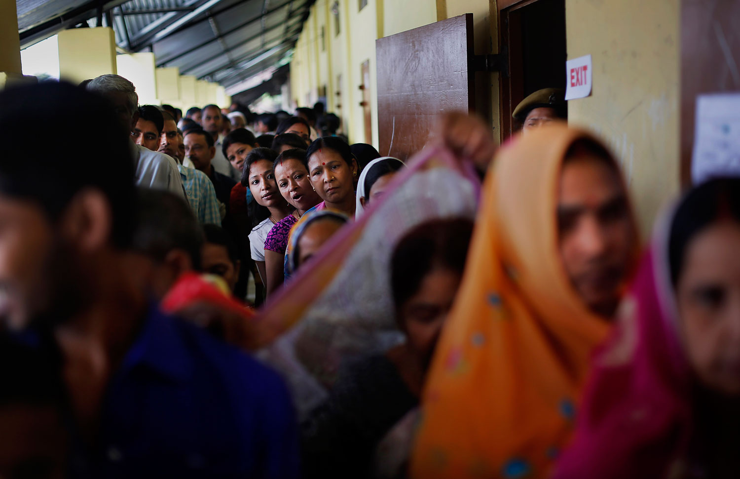 Indian voters wait in queues to cast their votes during the first phase of elections in Dibrugarh, in the northeastern state of Assam, India, April 7, 2014.