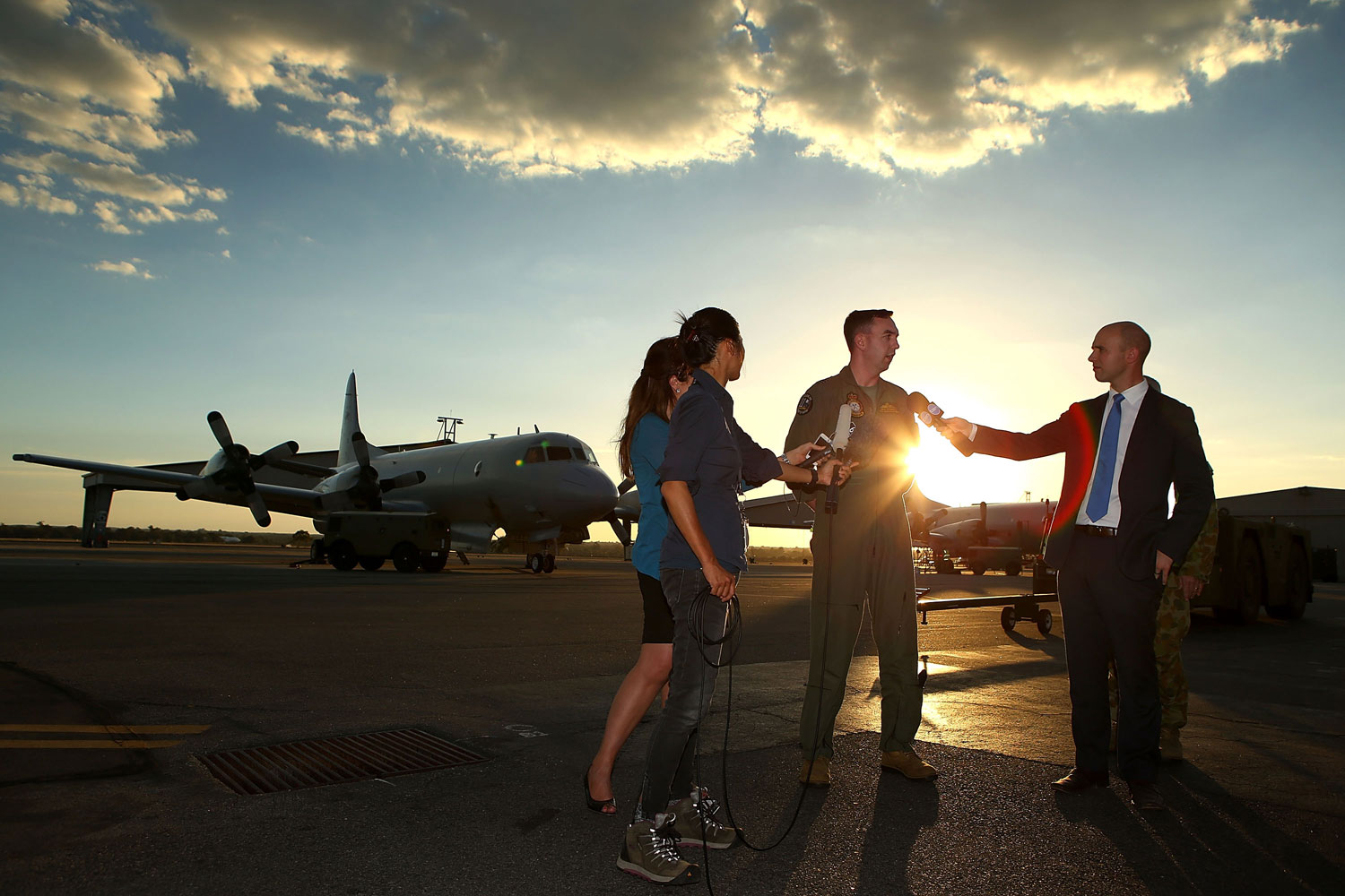 RAAF P3 Orion captain Flt Lt Benn Carroll speaks to reporters after returning from a search mission for debris from missing Malaysia Airlines flight MH370 at RAAF Base Pearce on April 8, 2014 in Perth, Australia.