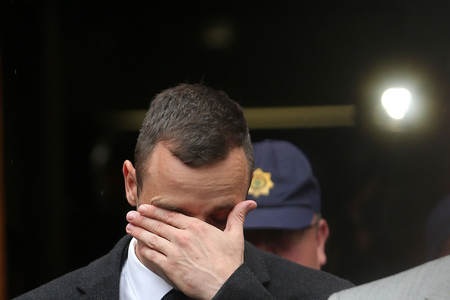 Oscar Pistorius, leaves the high court in Pretoria, South Africa, Monday, April 14, 2014.