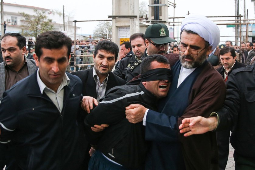 Balal, who killed an Iranian youth Abdolah Hosseinzadeh in a street fight with a knife in 2007, is brought to the gallows during his execution ceremony in the northern city of Nowshahr on April 15, 2014.