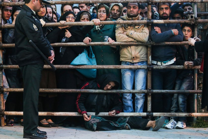 The mother of an Iranian man Balal, who killed a fellow Iranian Abdolah Hosseinzadeh in a street fight with a knife in 2007, asks for the family's forgiveness as her son is brought to the gallows during his execution ceremony in the northern city of Nowshahr on April 15, 2014.