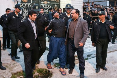 Balal, who killed an Iranian youth Abdolah Hosseinzadeh in a street fight with a knife in 2007, is brought to the gallows by judicial officals during his execution ceremony in the northern city of Nowshahr on April 15, 2014.