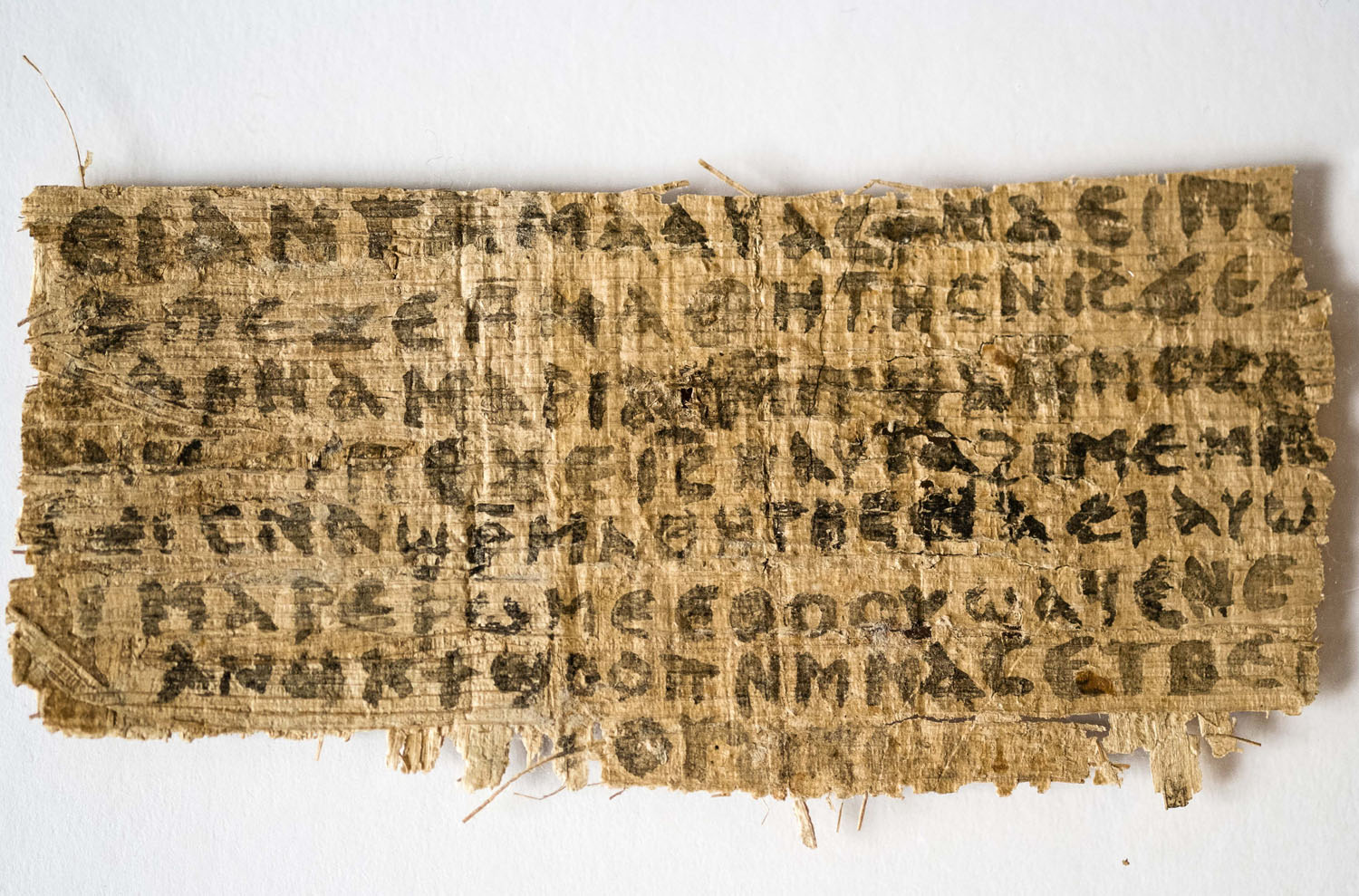 This Sept. 5, 2012 photo released by Harvard University shows a fourth century fragment of papyrus that divinity professor Karen L. King says is the only existing ancient text that quotes Jesus explicitly referring to having a wife.