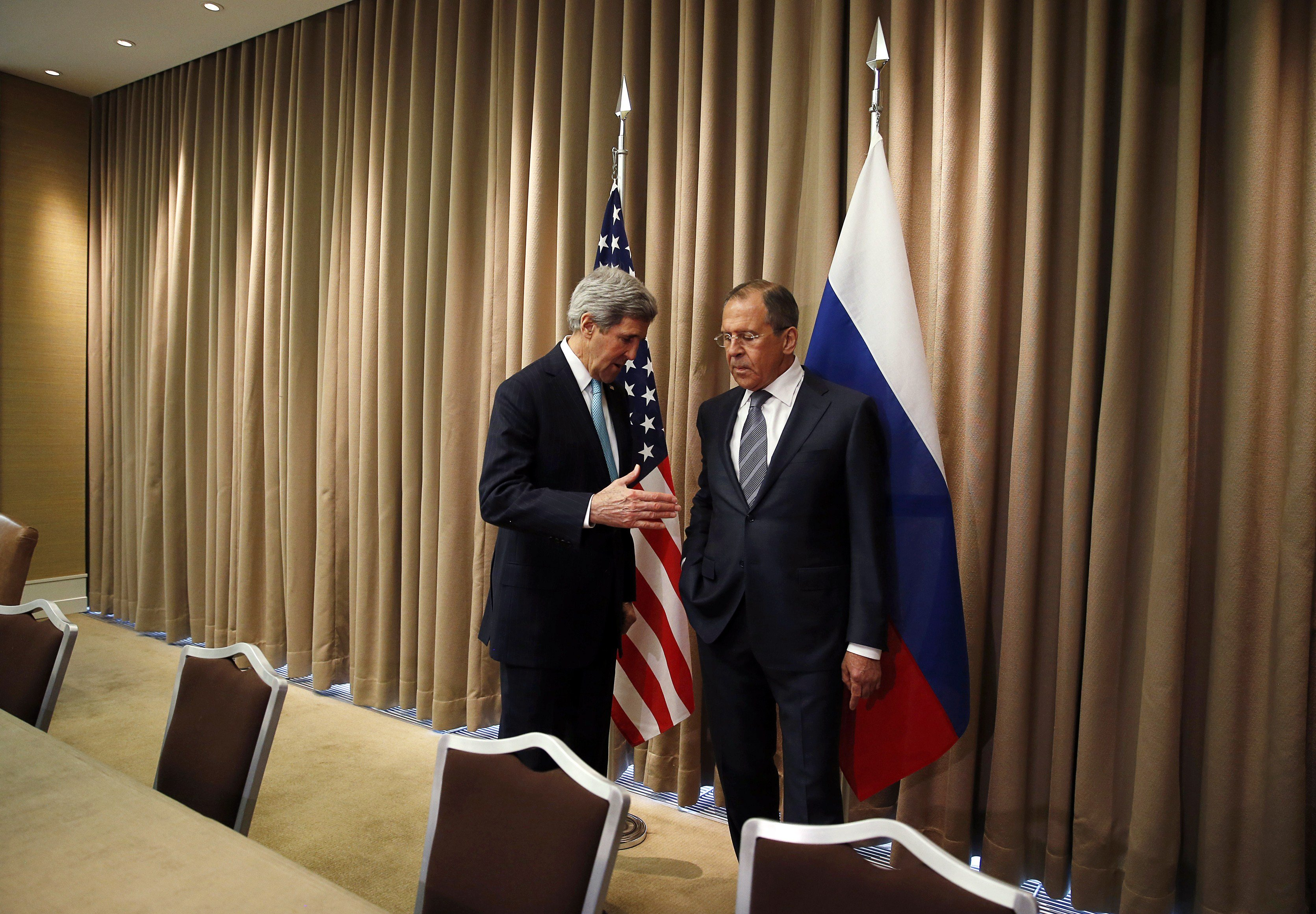 From left: U.S. Secretary of State John Kerry talks with Russian Foreign minister Sergei Lavrov at the start of a bilateral meeting to discuss the ongoing situation in Ukraine on April 17, 2014 in Geneva.