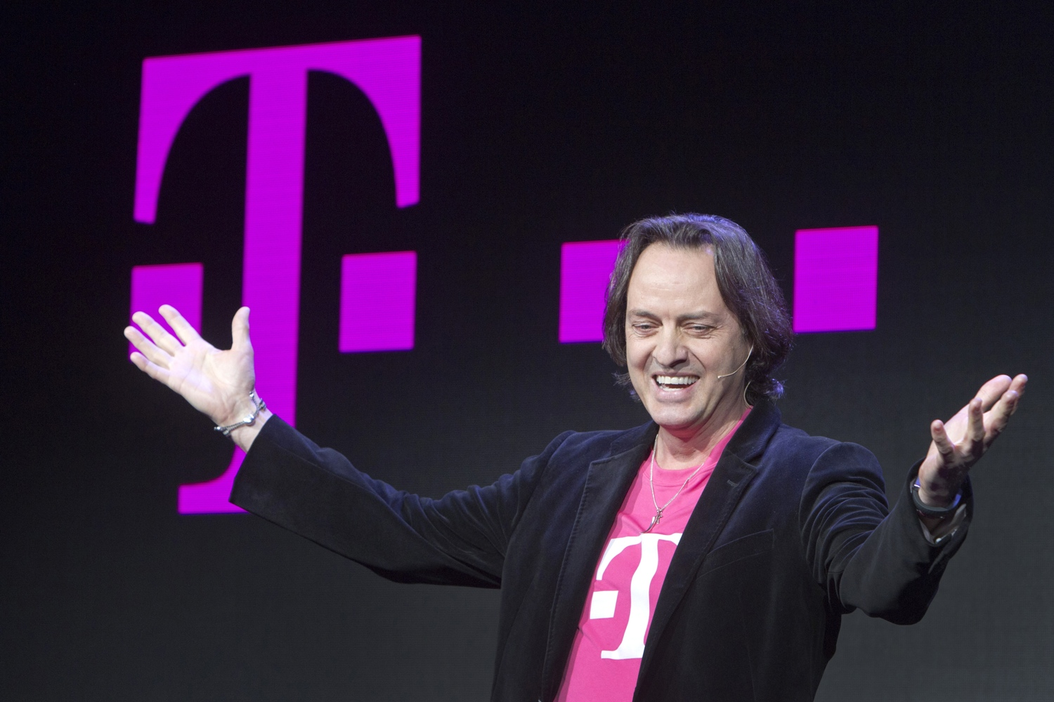 T-Mobile CEO John Legere speaks during a news conference at the 2014 International Consumer Electronics Show (CES) in Las Vegas, Nevada, January 8, 2014.