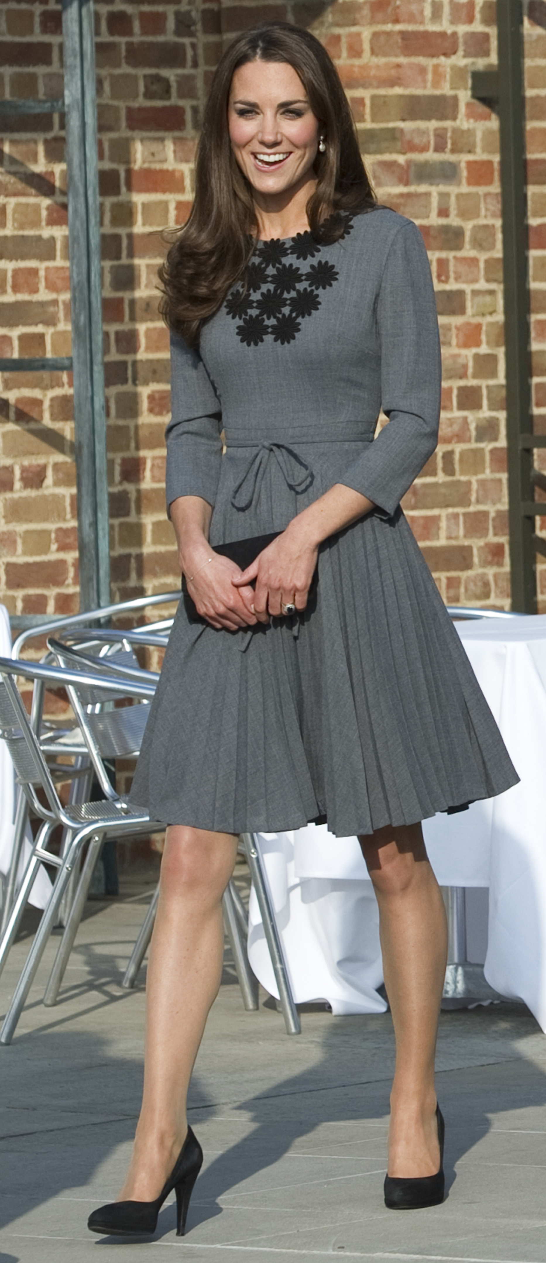 <strong>Going Grey</strong>                                   After her stop on the hockey field, the Duchess switched into a grey Orla Kiely shift to visit Prince Charles' Foundation for Children and the Arts at Dulwich Gallery in South London.
