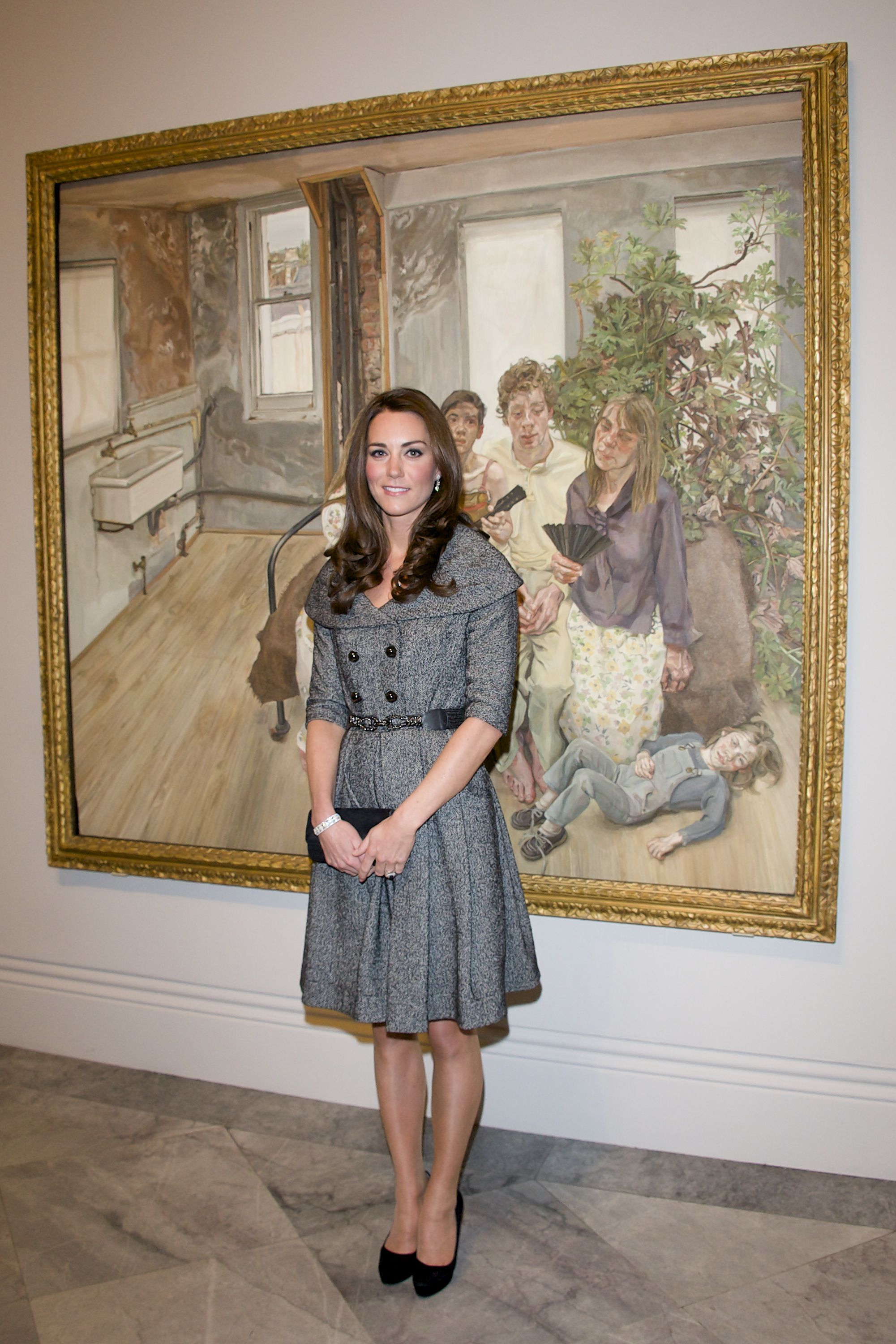 <strong>Flying Solo</strong>On Feb. 8, 2012, the Duchess wore a belted gray dress and black pumps to attend a Lucian Freud exhibition at the National Portrait Gallery in London. With Prince William away on military duty, the appearance marked Middleton's first solo official engagement as a royal.