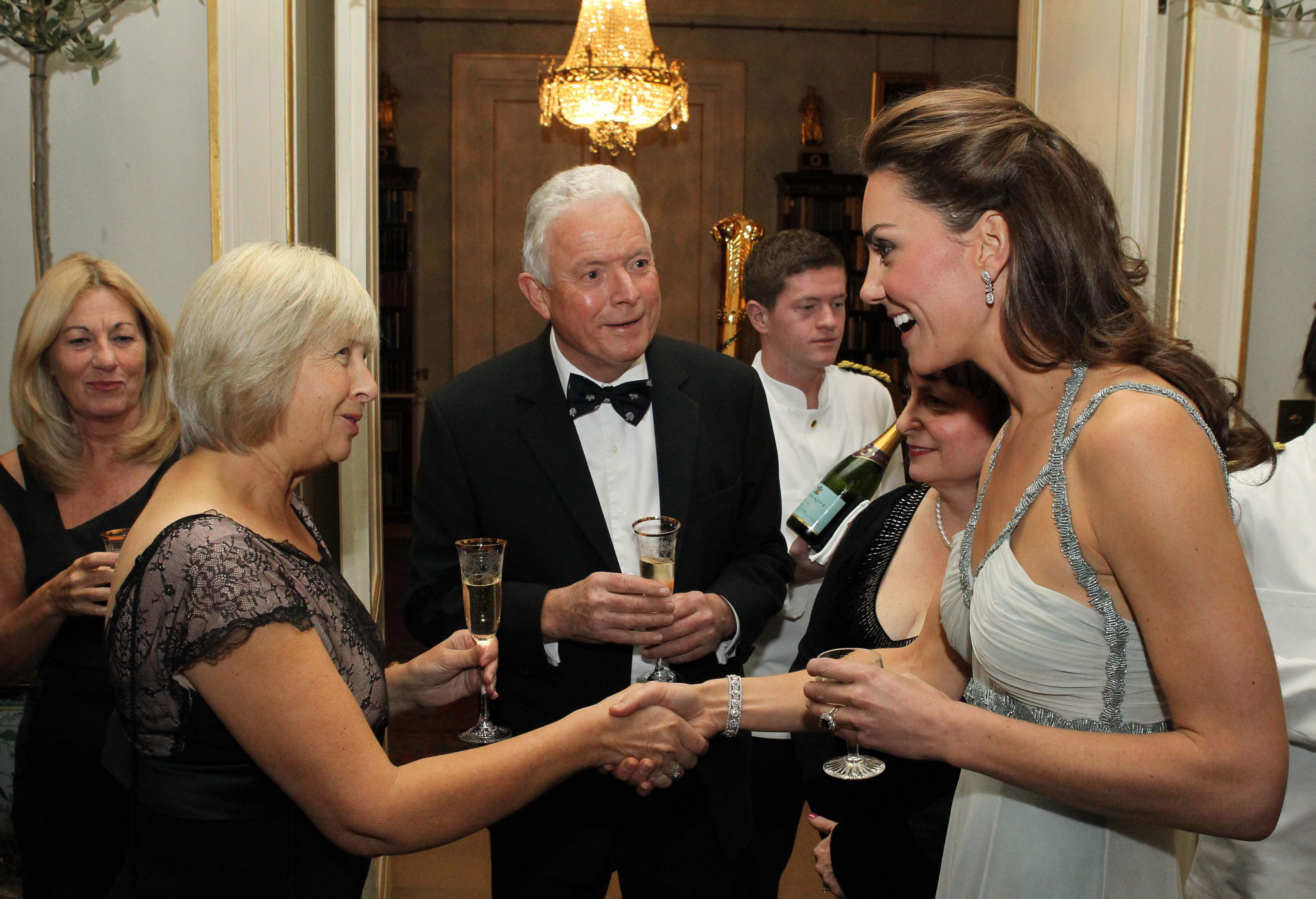 <strong>Going Solo in Silver</strong>                                   Middleton hosted her first official solo engagement on Oct. 26, 2011, after Prince Charles had to travel to Saudi Arabia to pay condolences to the royal family following the death of the Crown Prince. She chose a silver Amanda Wakeley gown to fete In Kind Direct, a charity founded by Prince Charles in 1996.