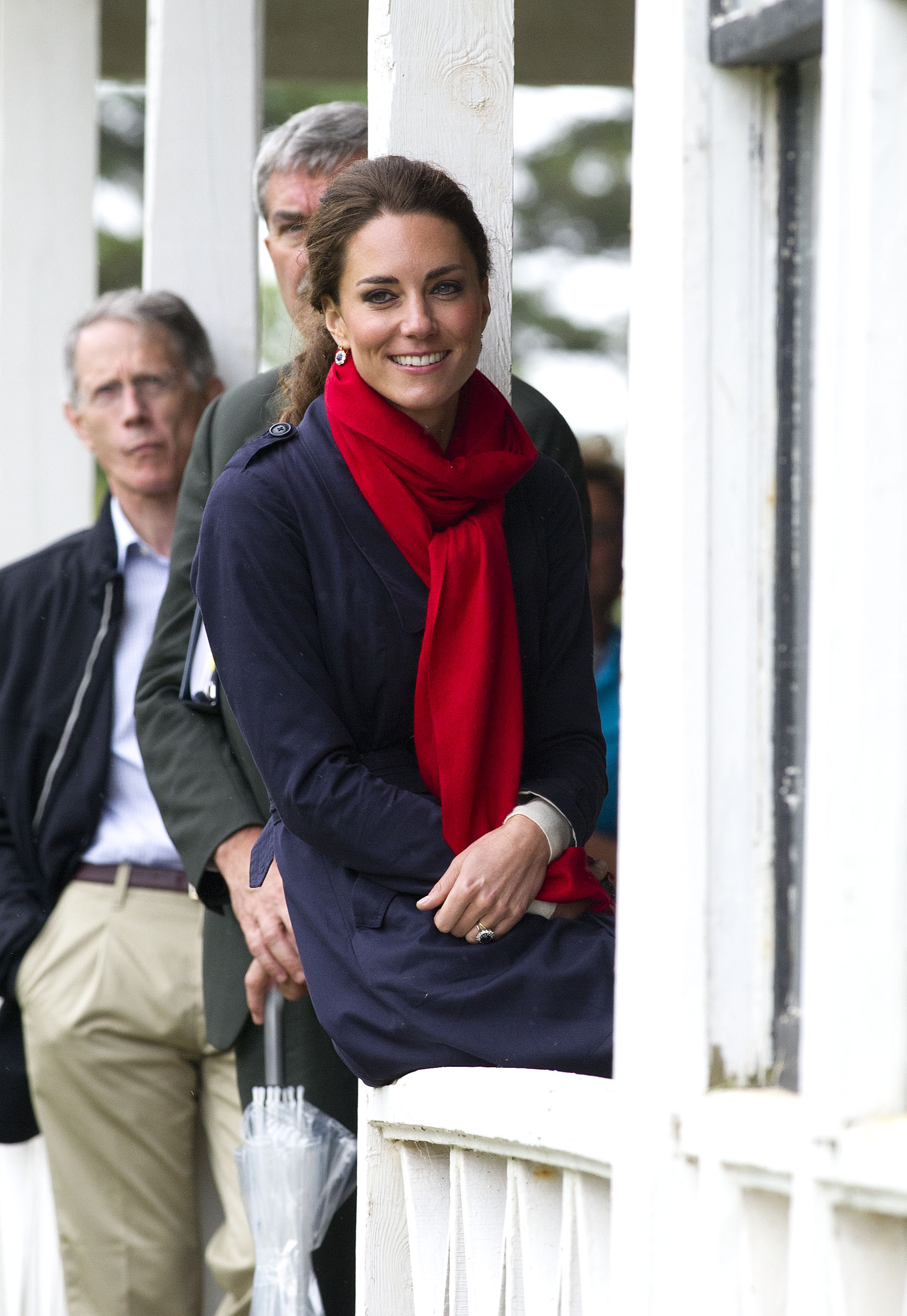 <strong>In the Trenches</strong>                                   The Duchess wore a navy blue trench coat, accessorized with a red scarf, on July 4, 2011, in Charlottetown, Canada. Her appearance in a beige Burberry trench coat in 2010 led the jacket to sell out in stores immediately.