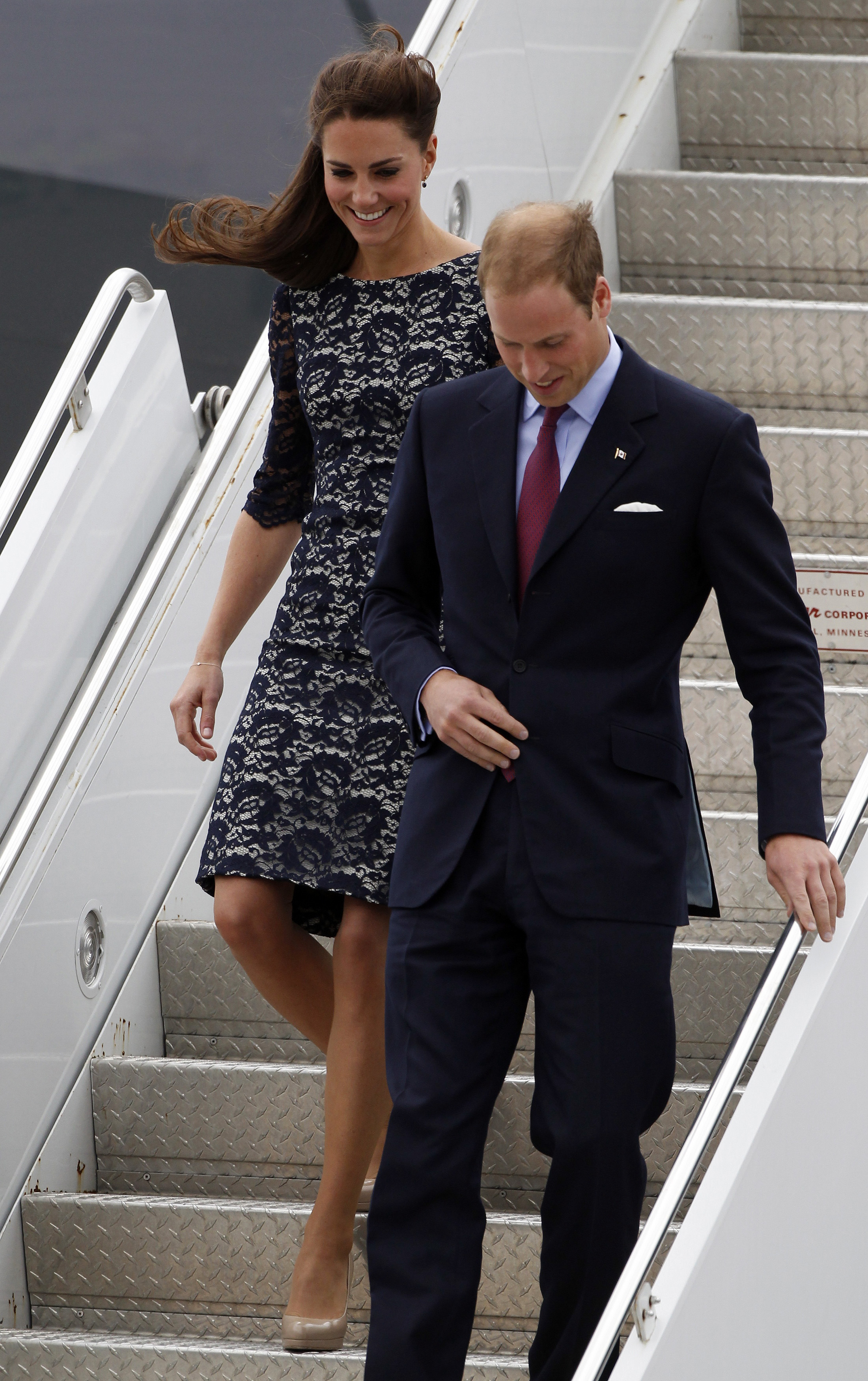 <strong>Lovely in Lace</strong>                                   The Duchess arrived in Ottawa on June 30, 2011, in another navy blue dress, but pinned part of her hair back for a new look.