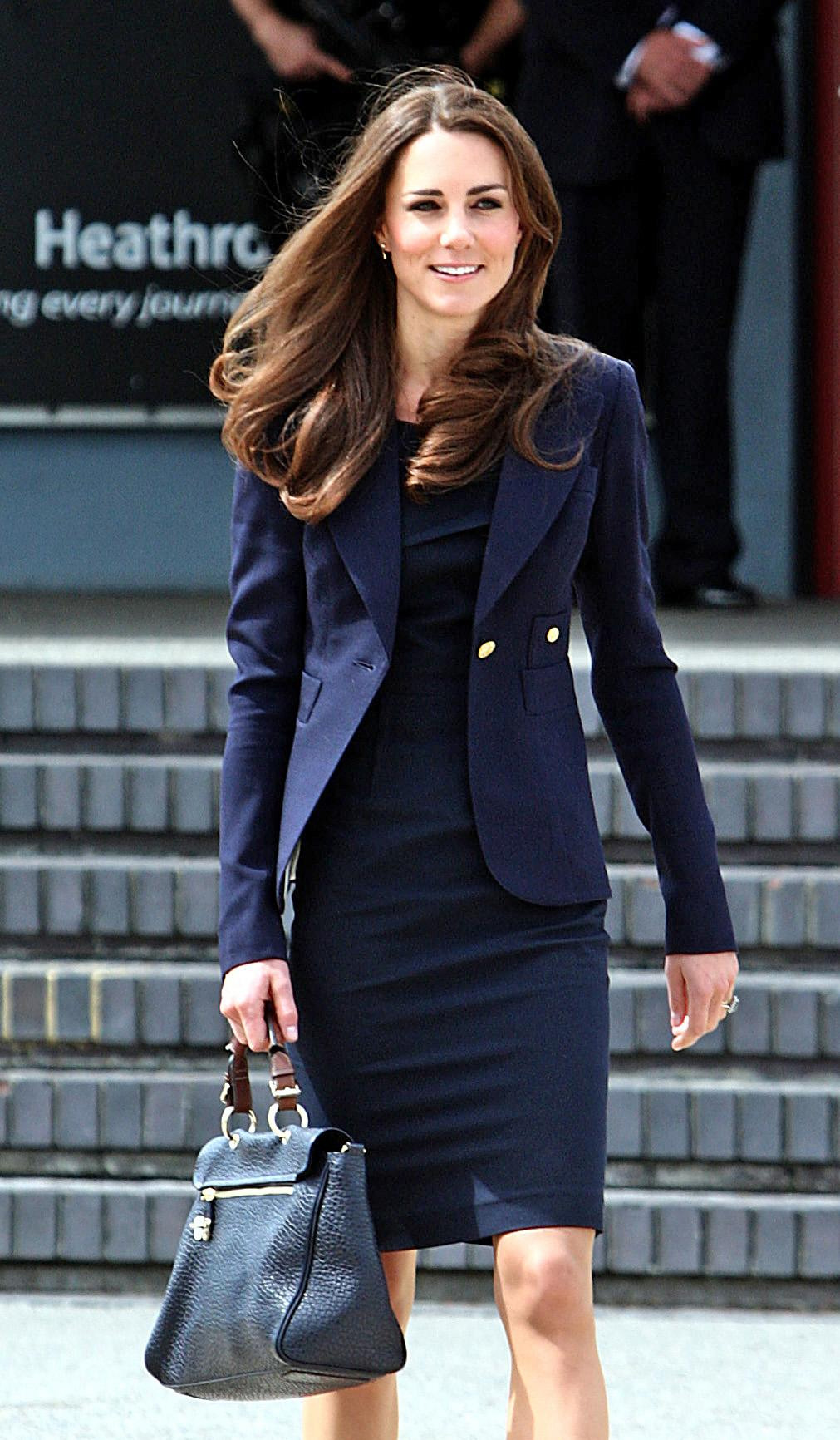 <strong>Heading to Heathrow</strong>                                   On June 30, 2011, the Duchess departed London in a navy blue ensemble that included a Roland Mouret shift, Smythe blazer and Mulberry bag. The trip marked her first international travel as a royal.