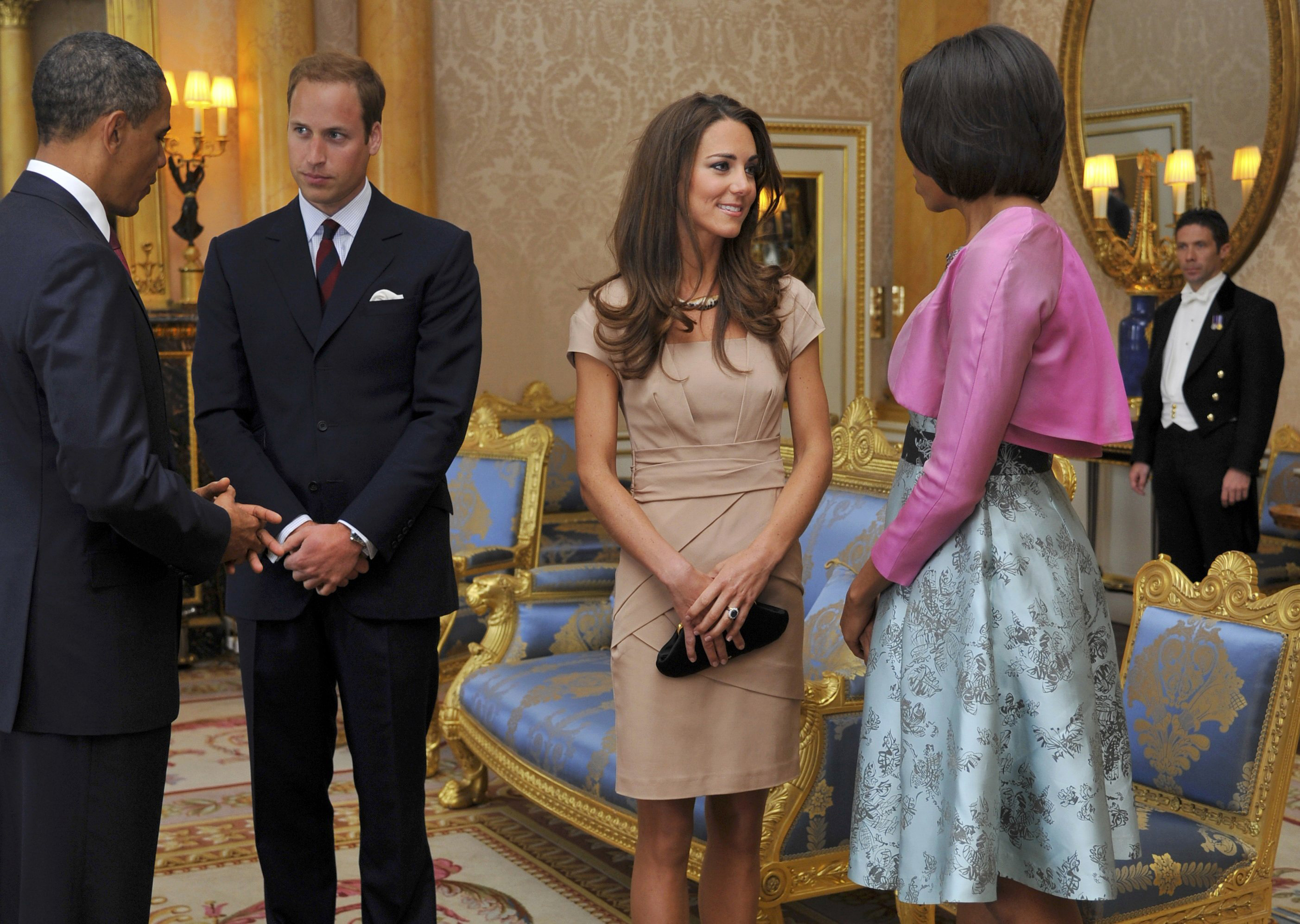 <strong>Fashion Royalty</strong>                                   The Duchess of Cambridge met Michelle Obama at Buckingham Palace in a short-sleeved beige Reiss shift and black pumps on May 24, 2011. The dress, made by the same designer of her engagement-portrait frock, sold out in the U.S. and crashed the retailer's website.