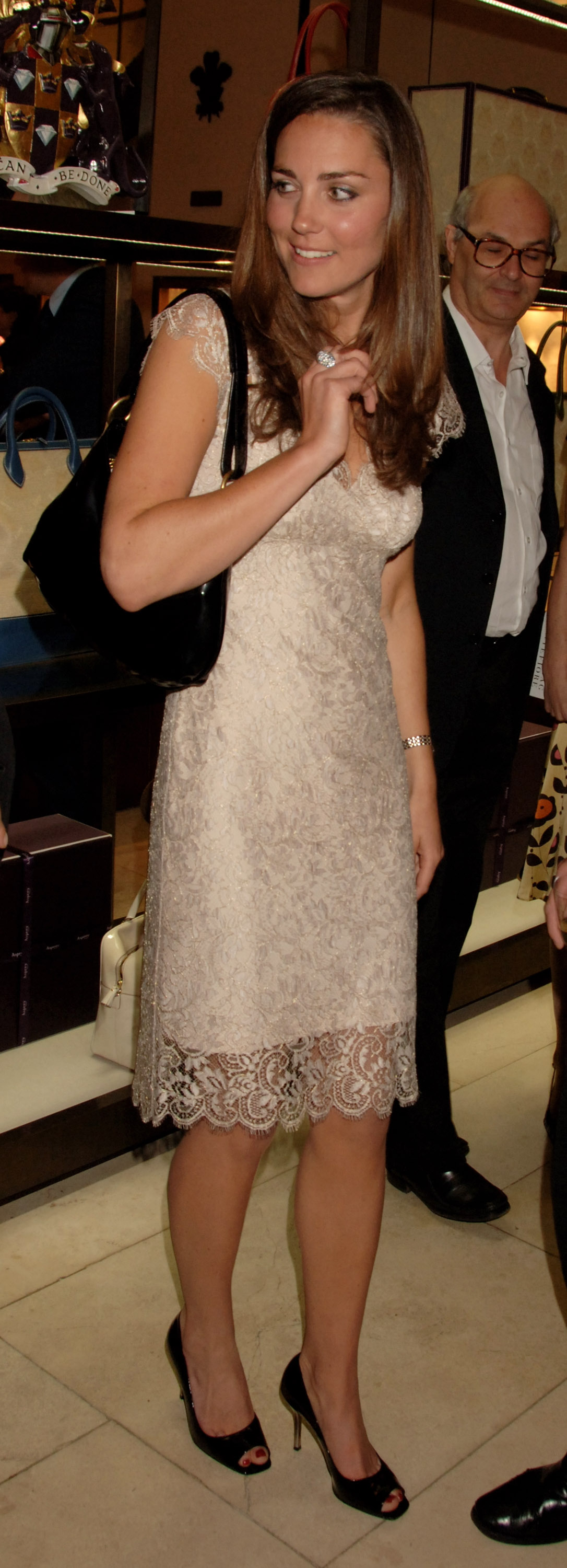 <strong>Lovely in Lace</strong>                                   Middleton chose a light pink shift with lace overlay for a book-launch party in London on May 14, 2007.